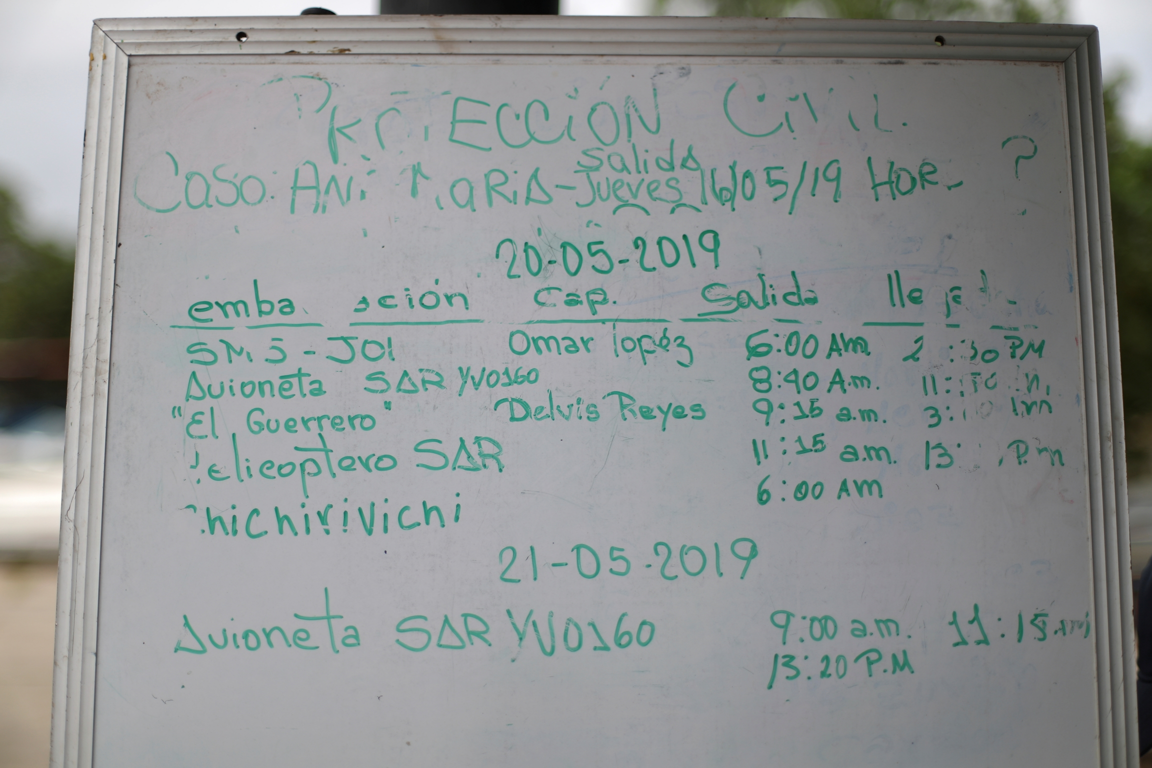 a whiteboard showing search and rescue operations