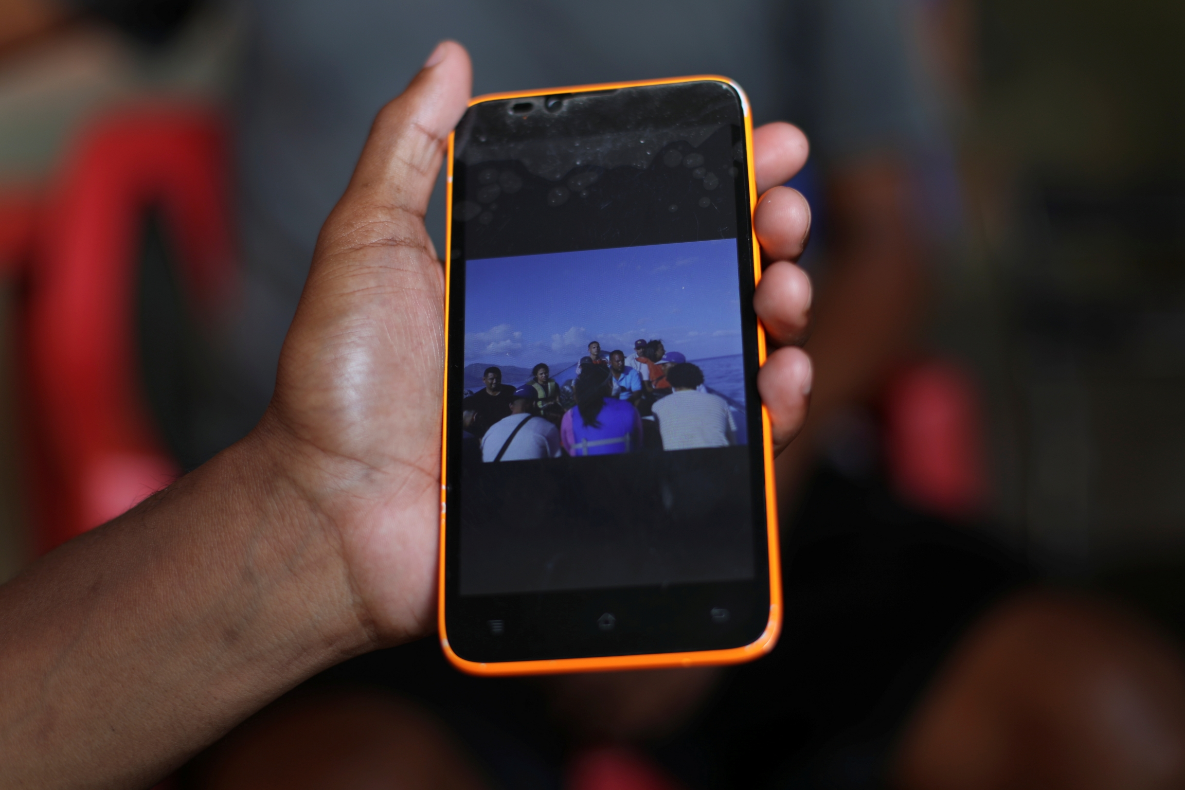 A friend of Maroly shows a picture of the boat that Maroly and her family boarded.
