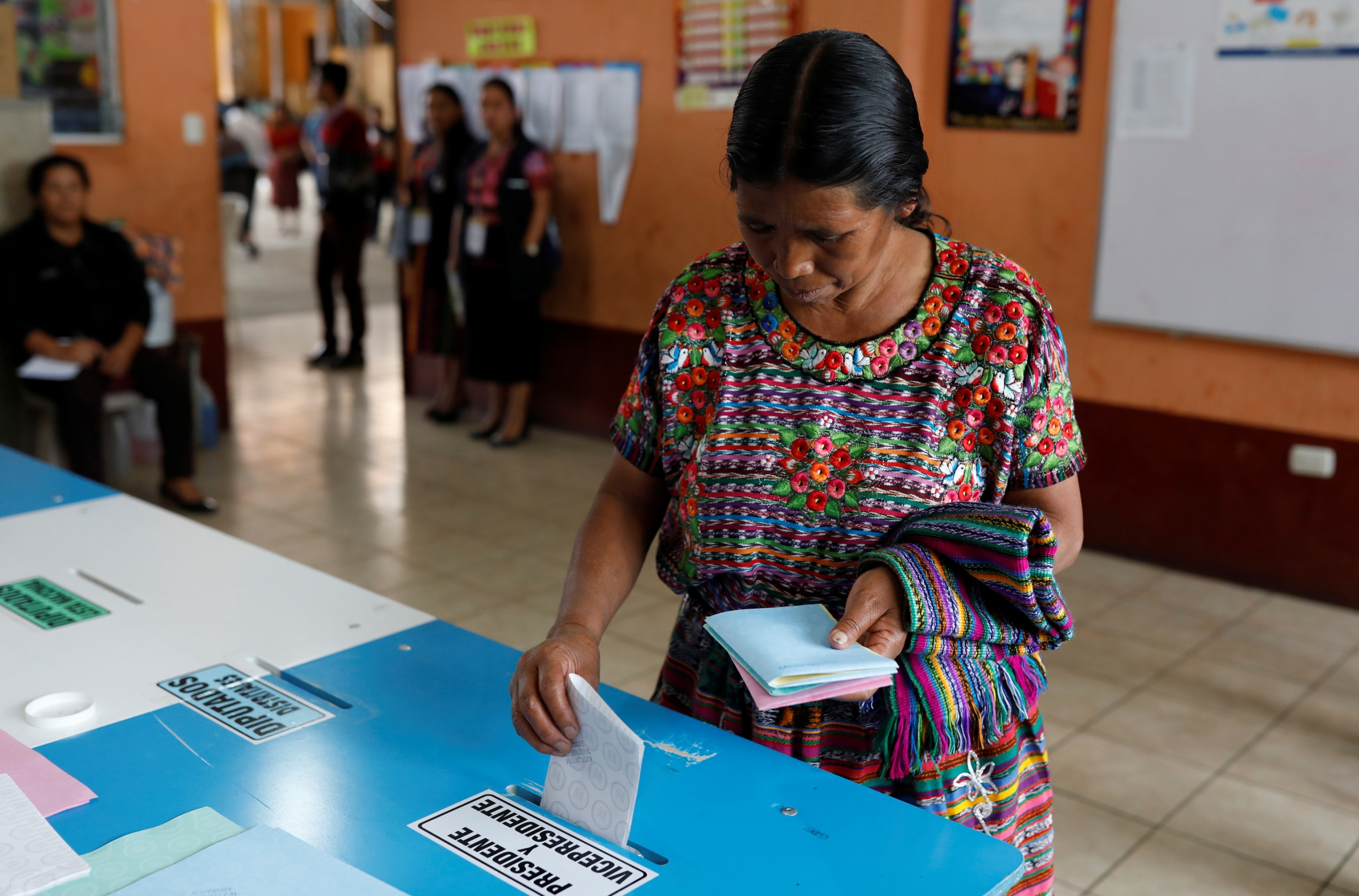 A woman votes at a polling station during the first round of Guatemala's presidential election in San Pedro Sacatepequez, Guatemala, June 16, 2019.