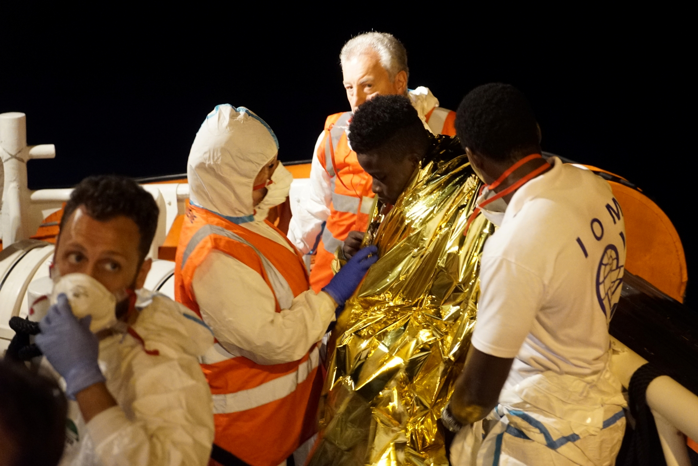 a migrant is rescued at sea