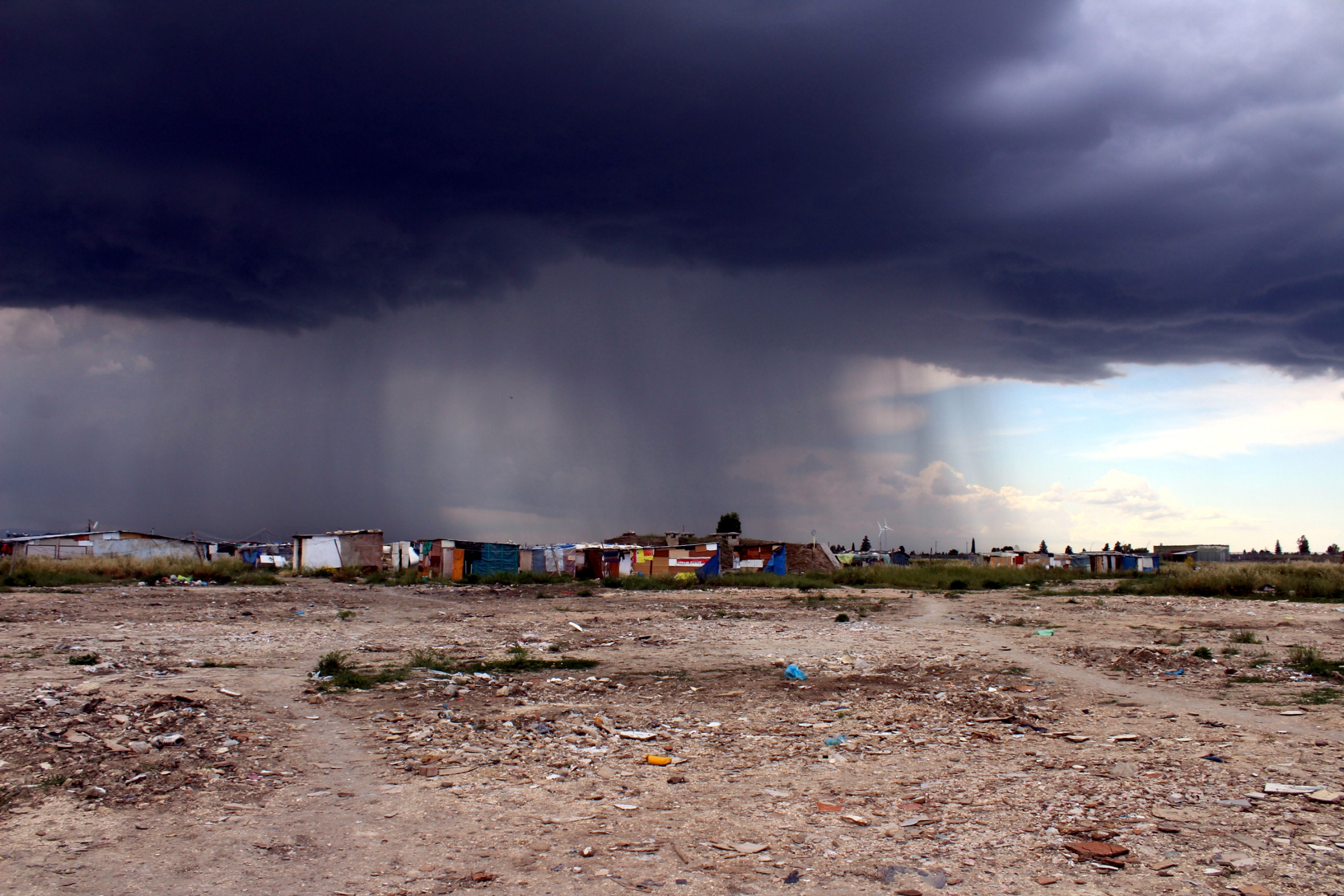 "Storm clouds gather over the ""ghetto"" where migrants live"
