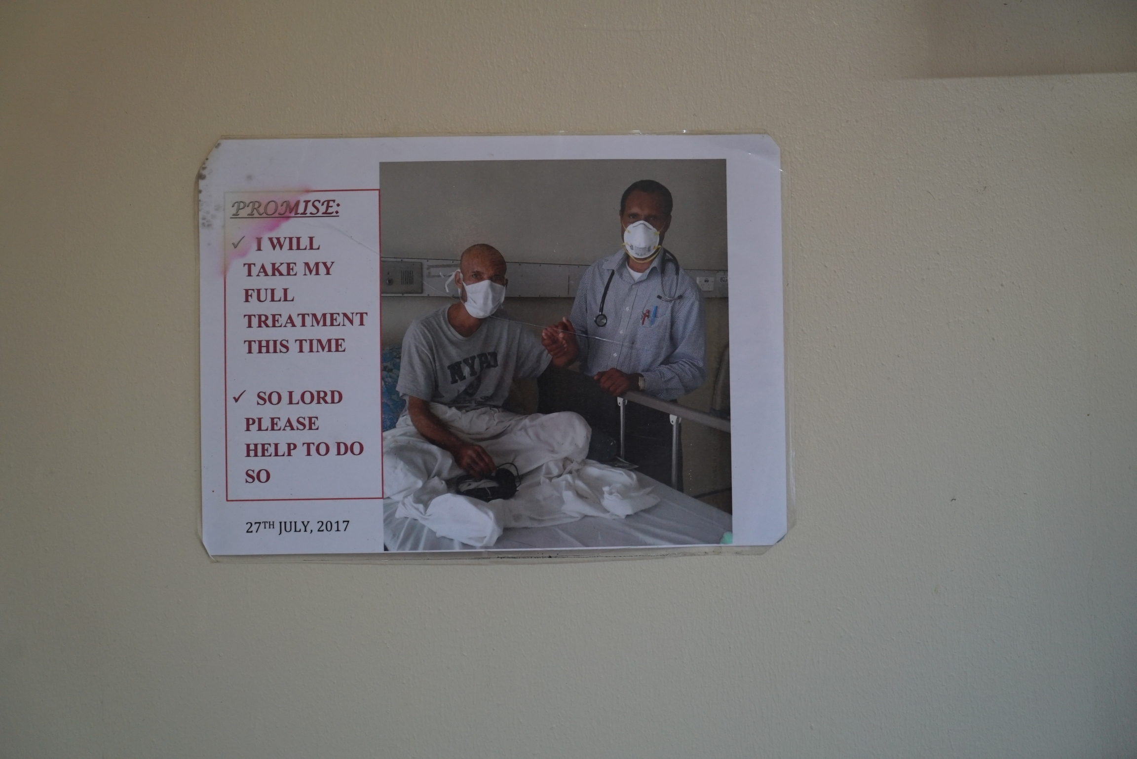 An image of a TB patient and his doctor hung on a wall