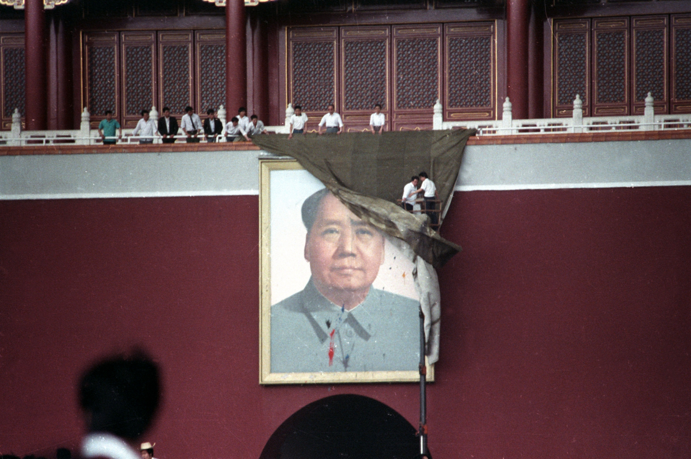 A portrait of Chairman Mao is covered.