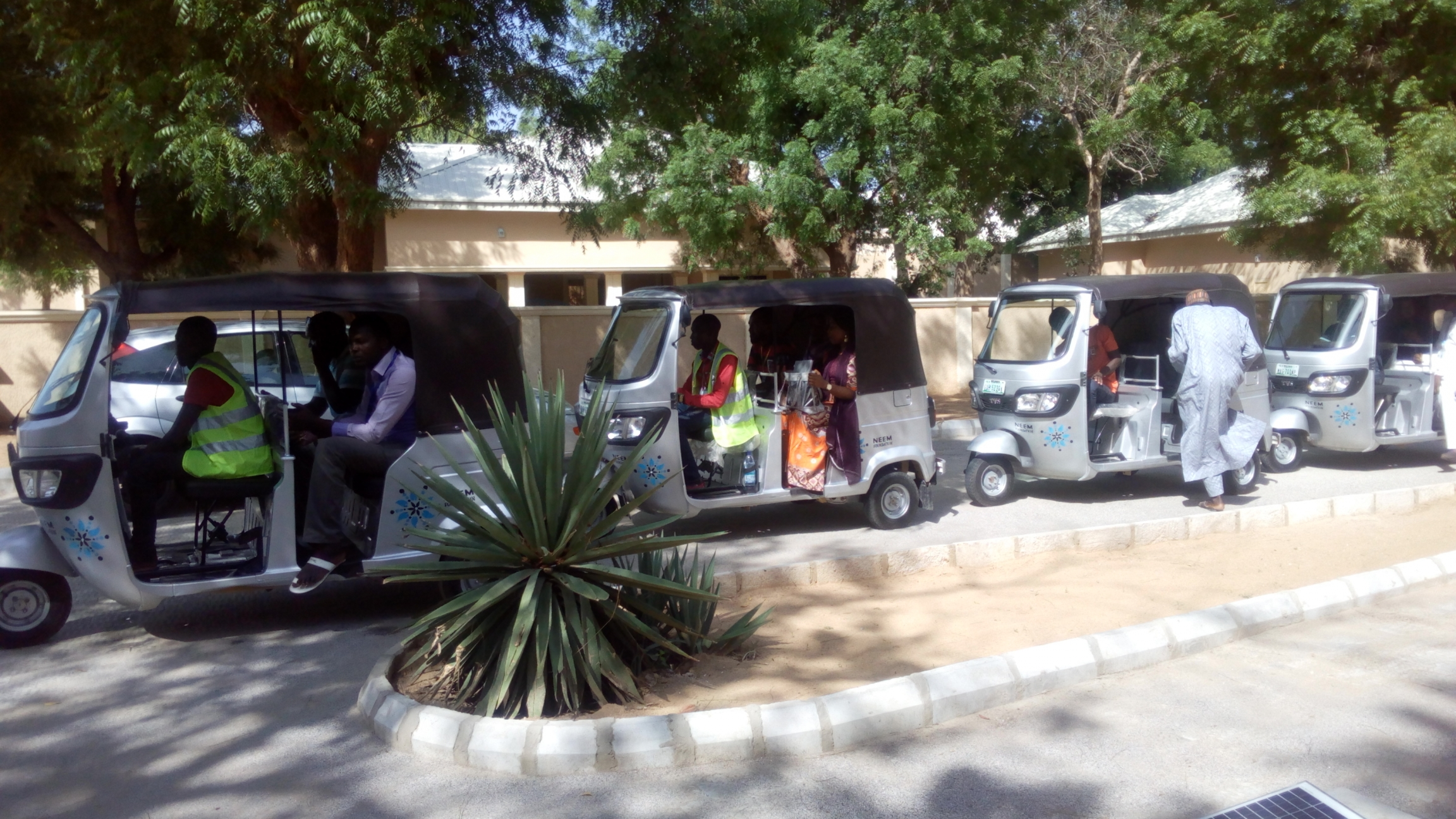 Counselors line up in tuk-tuks for house visits