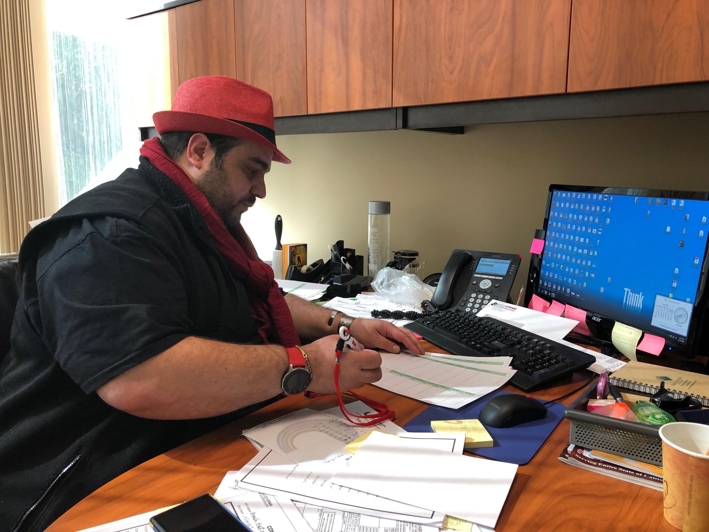 Program director Alireza Hekmatshoarat his office at the KIRN 670 studiosin Los Angeles