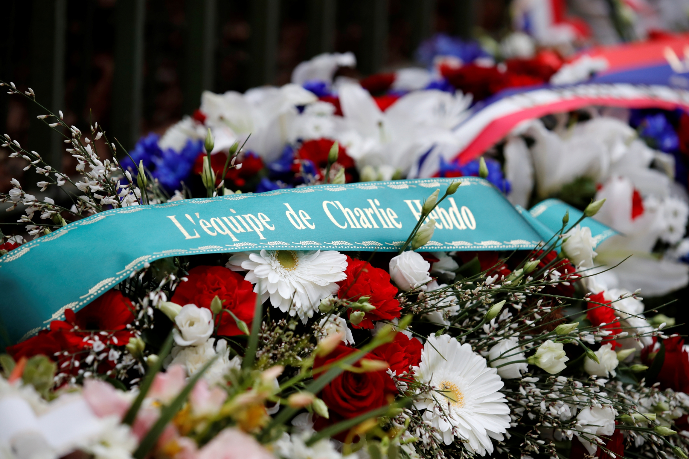 Bouquet of flowers memorializing Charlie Hebdo