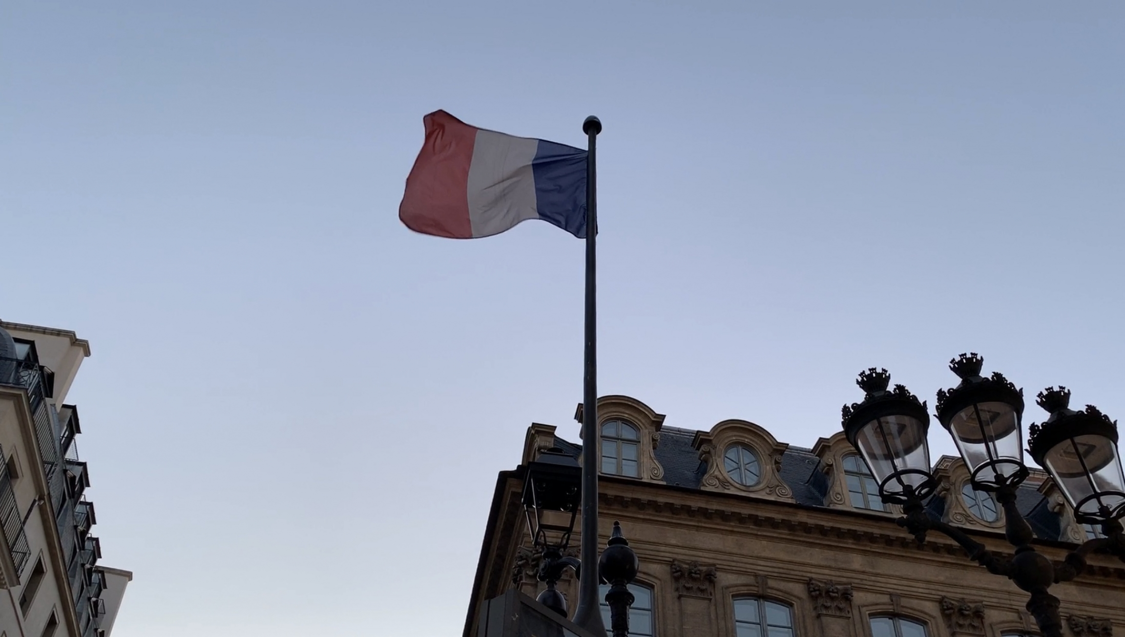 French flag waves at dusk