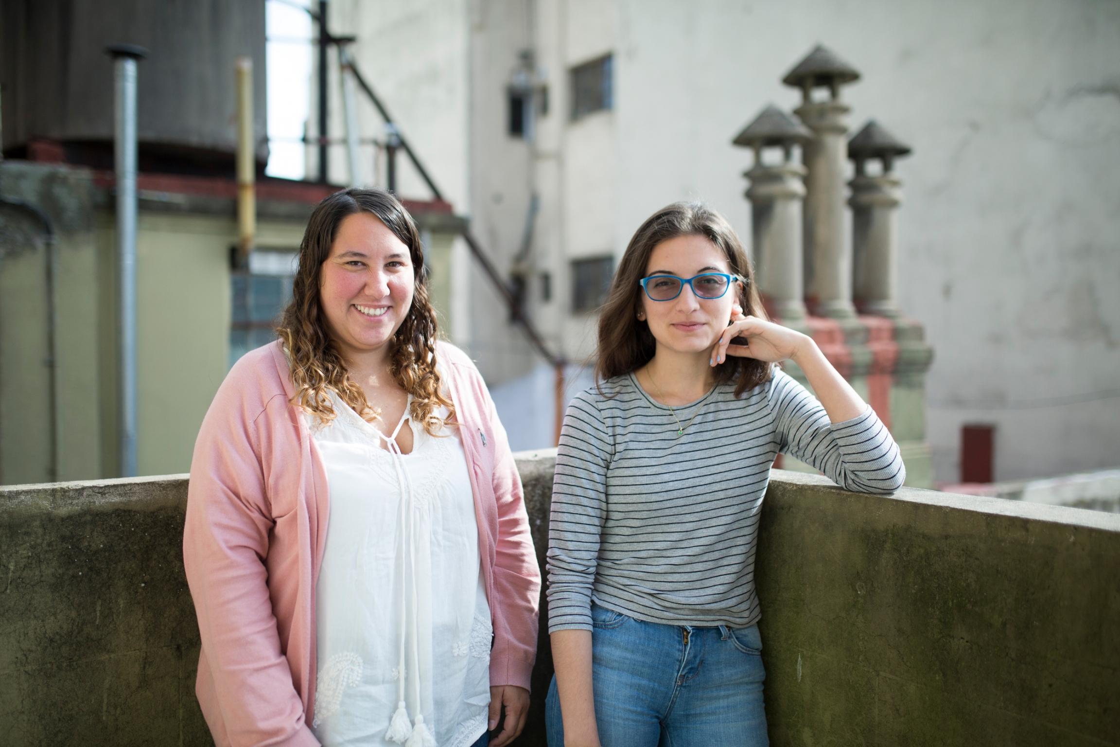 Two women standing outside.