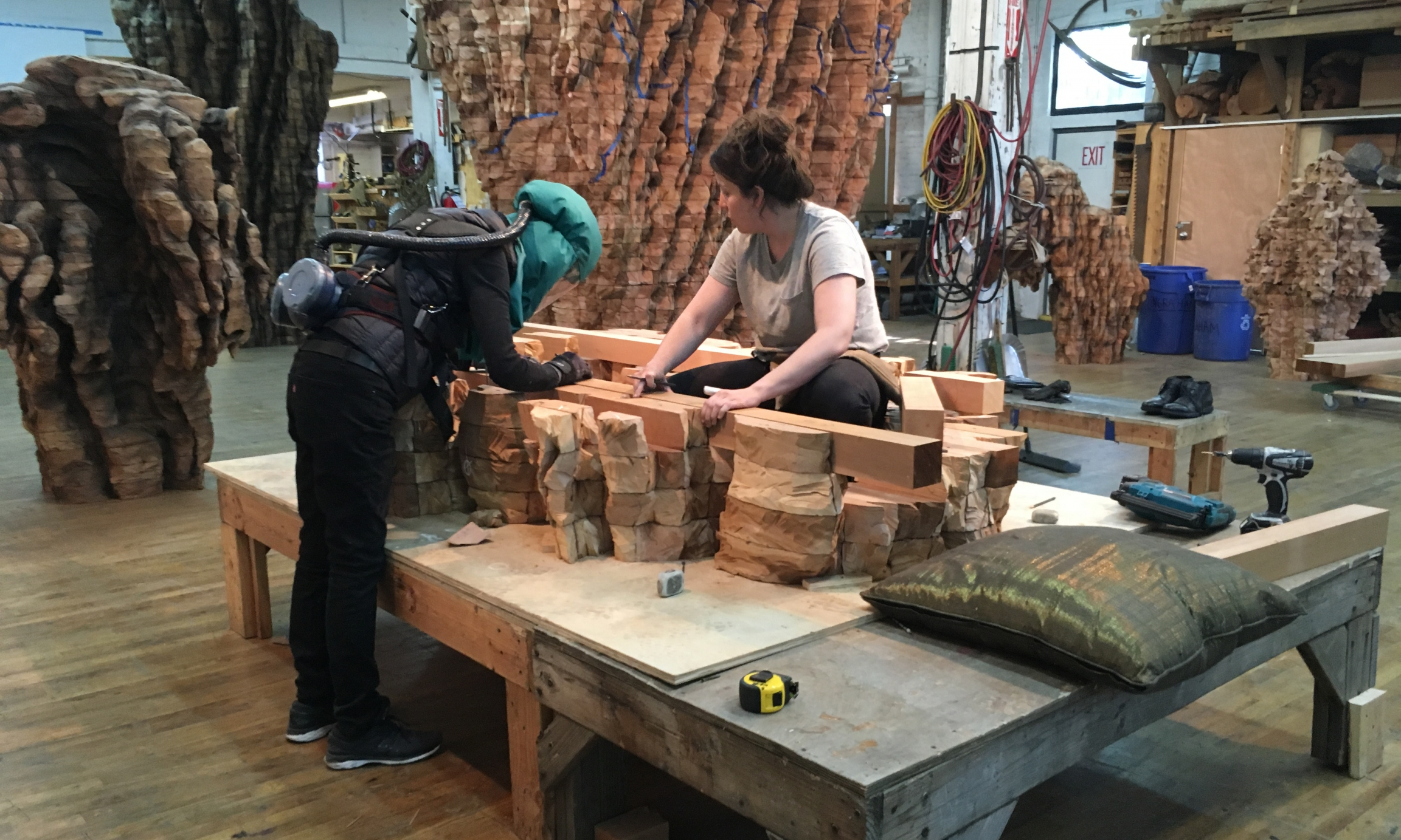 Ursula von Rydingsvard at work in her studio, with assistant Morgan Daly.