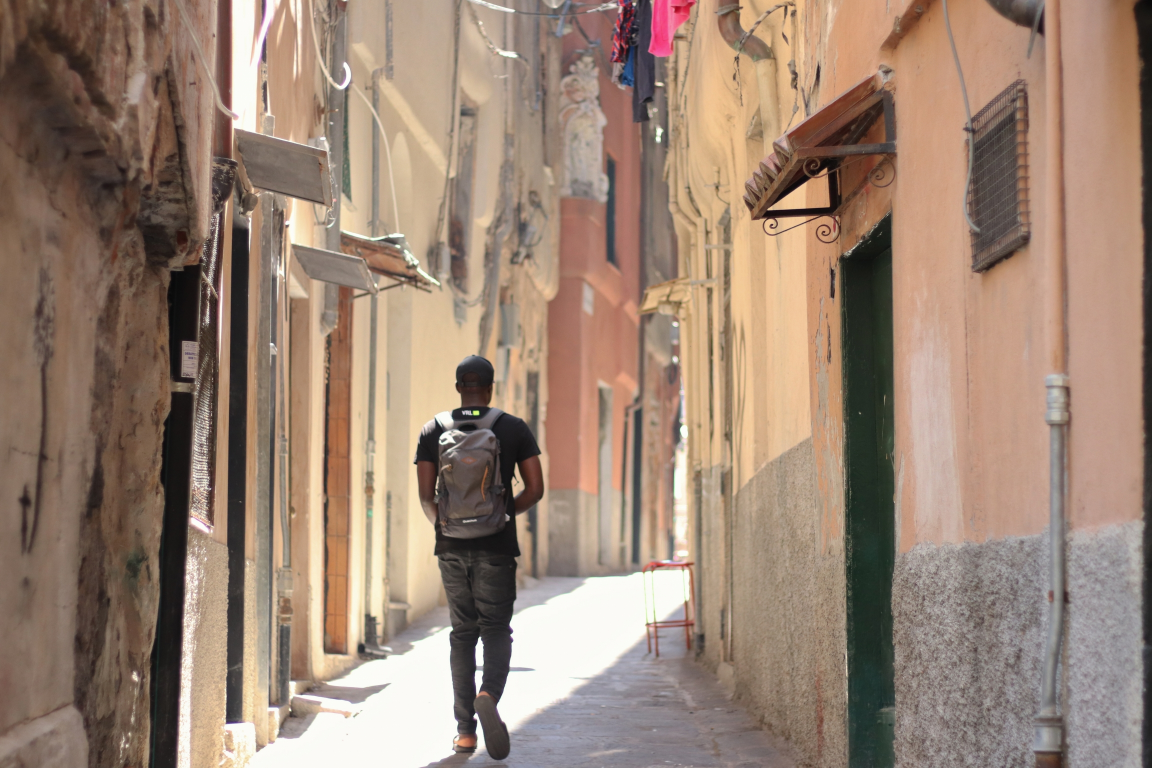 Moussa strolls through the center of Genoa.