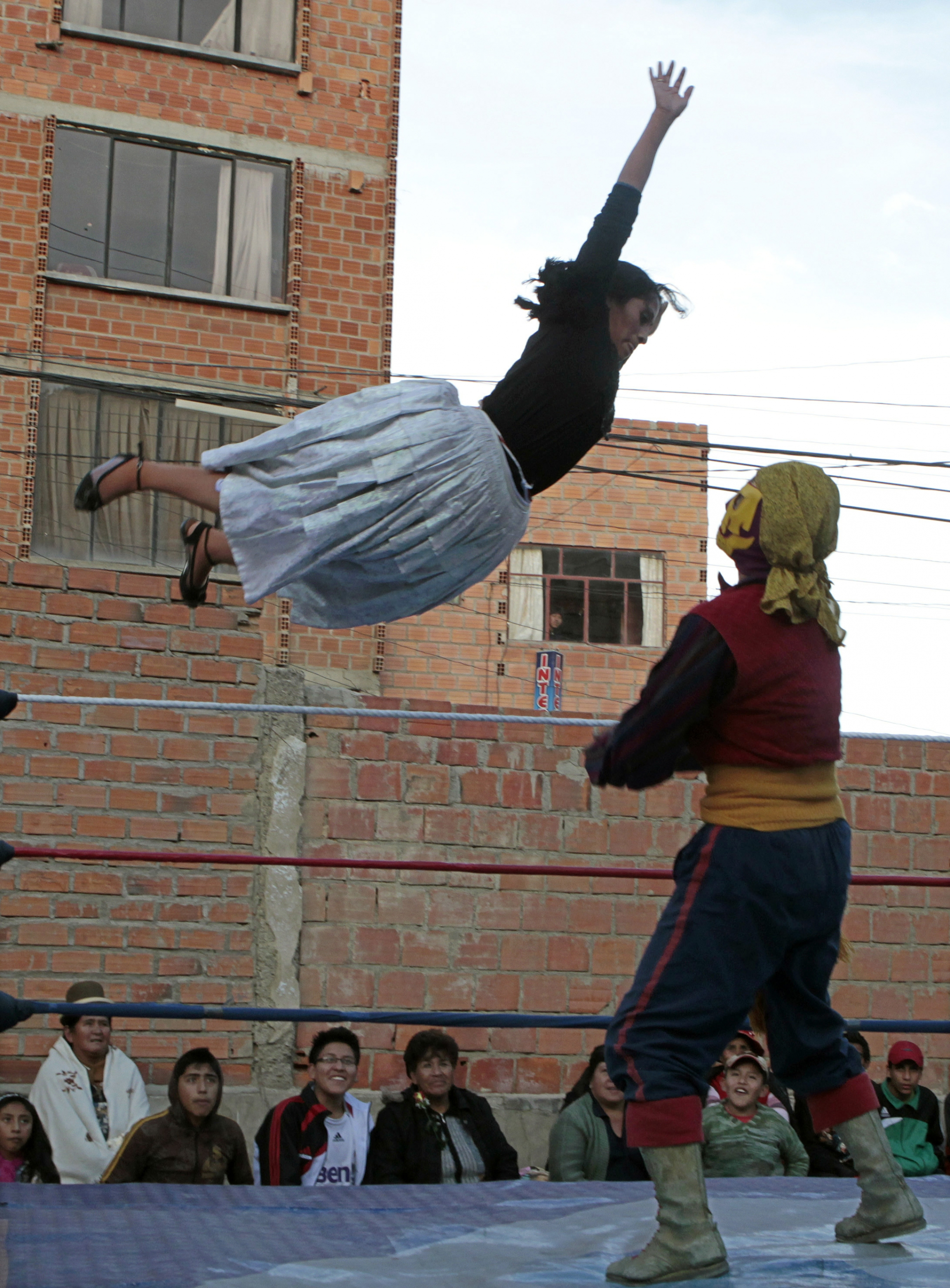 Two Bolivian cholitas wrestle