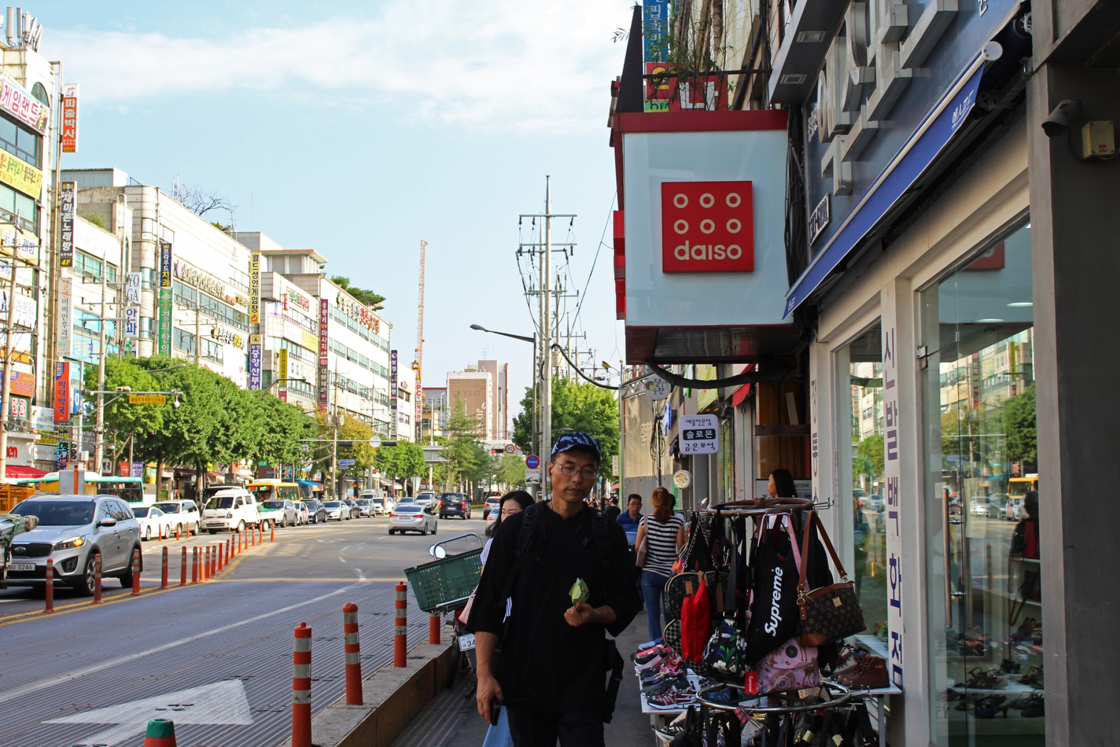 South Koreans walk past the entrance of a Daiso store in Bucheon, a satellite city of Seoul.