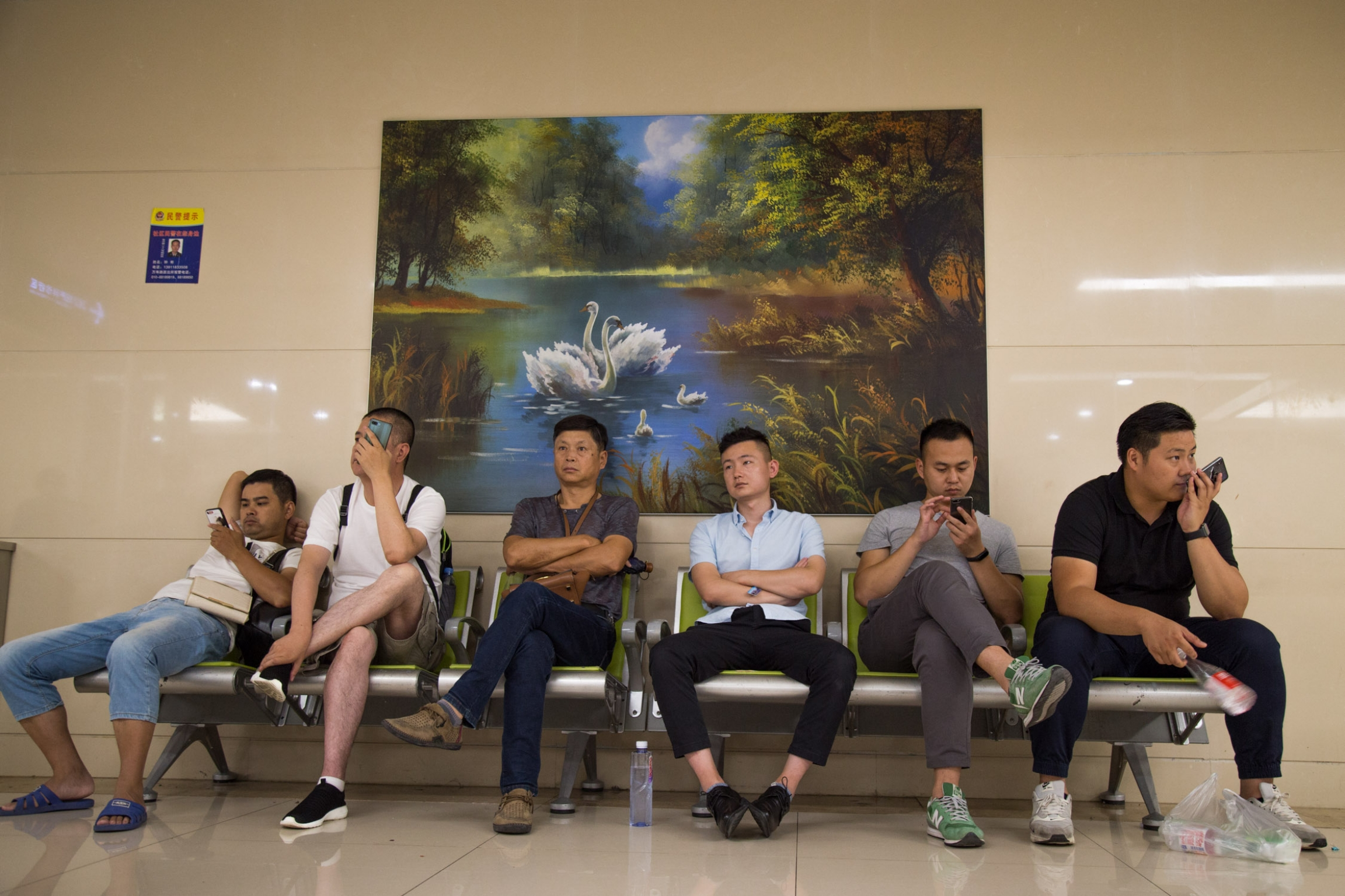 Men wait outside the gynecology consultation area at the People's Liberation Army General Hospital in Beijing, China on July 30, 2019.