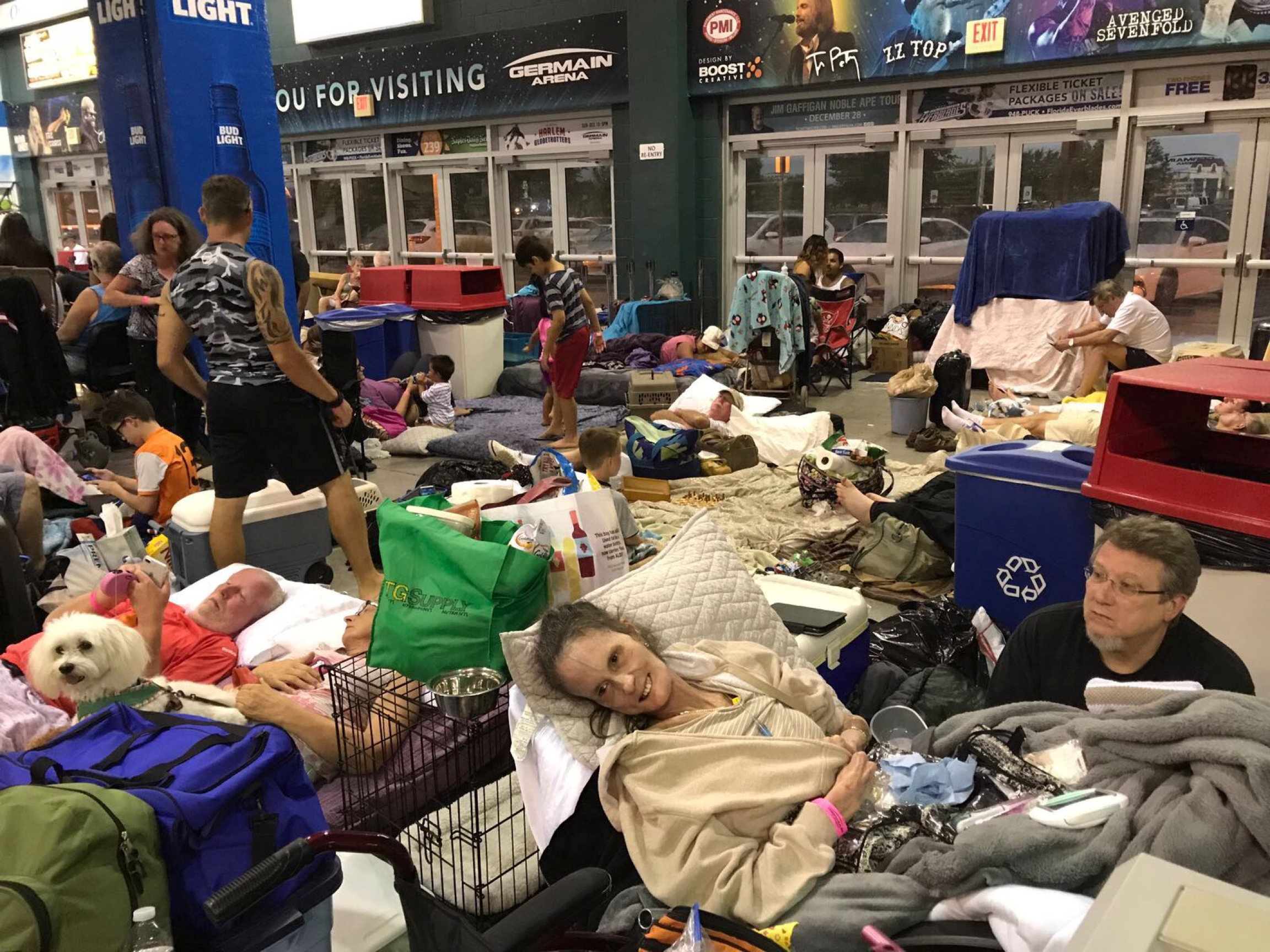 A sick woman and her husband in a shelter after storm