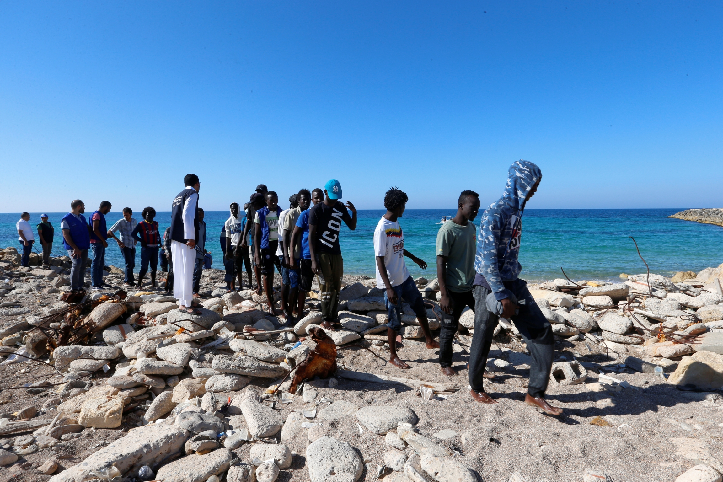 African migrants rescued by Libya coast guard at seashore