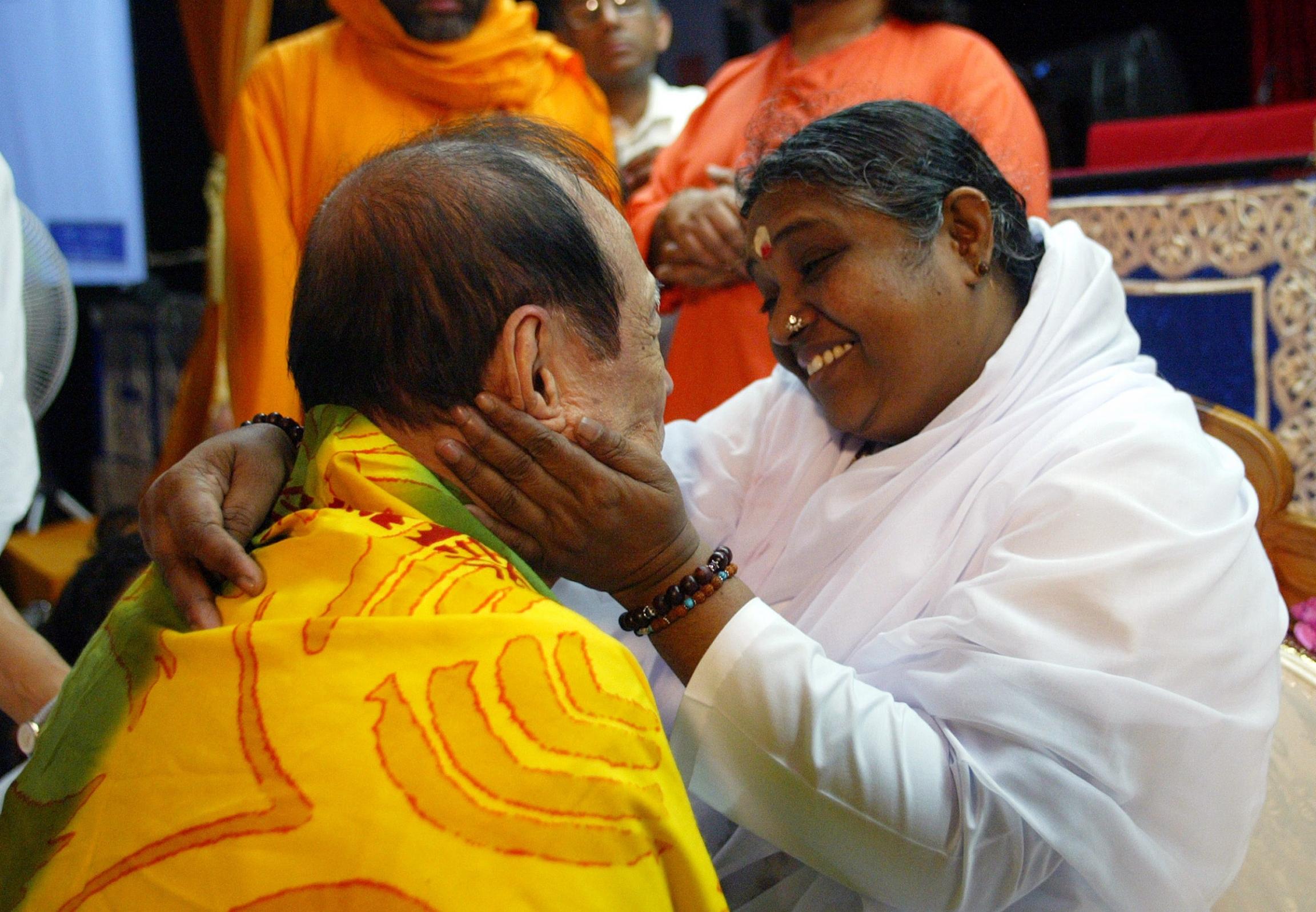 Amma looks lovingly at a devotee