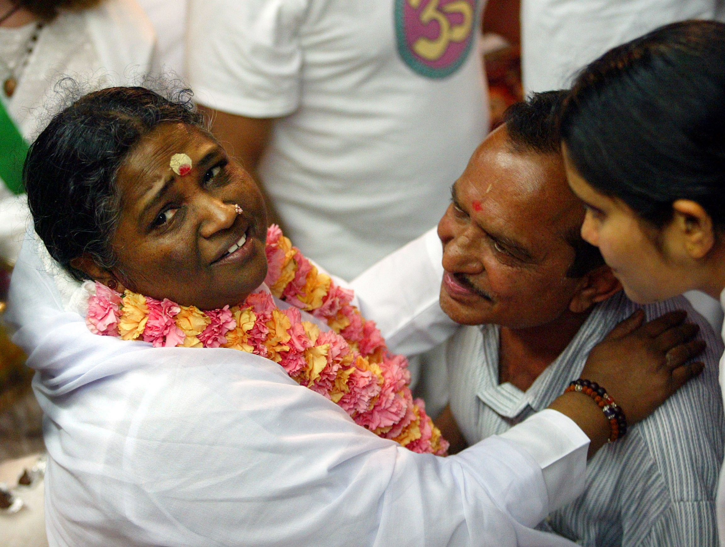 A man gets a hug from Amma.