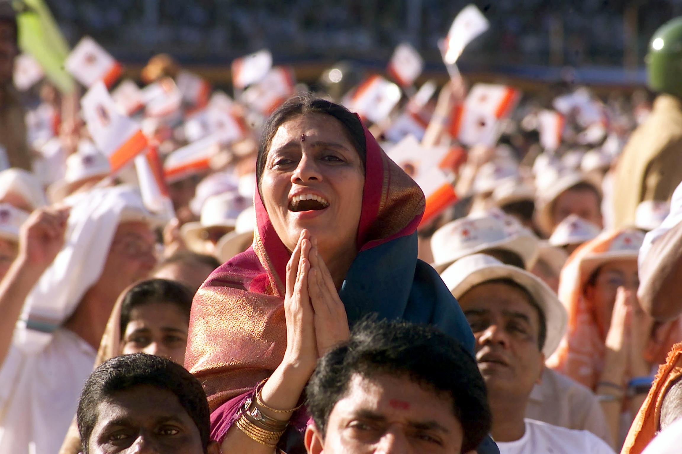 A woman exalts looking at a living god