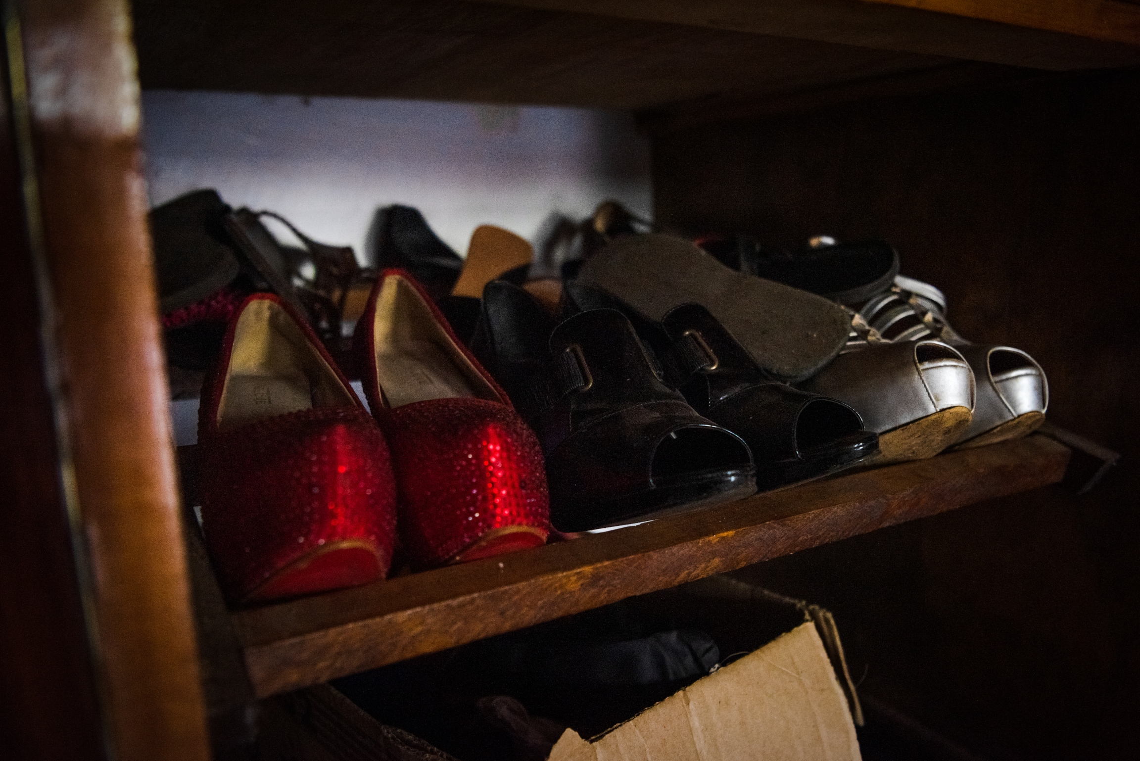 A row of high heeled shoes in red and black