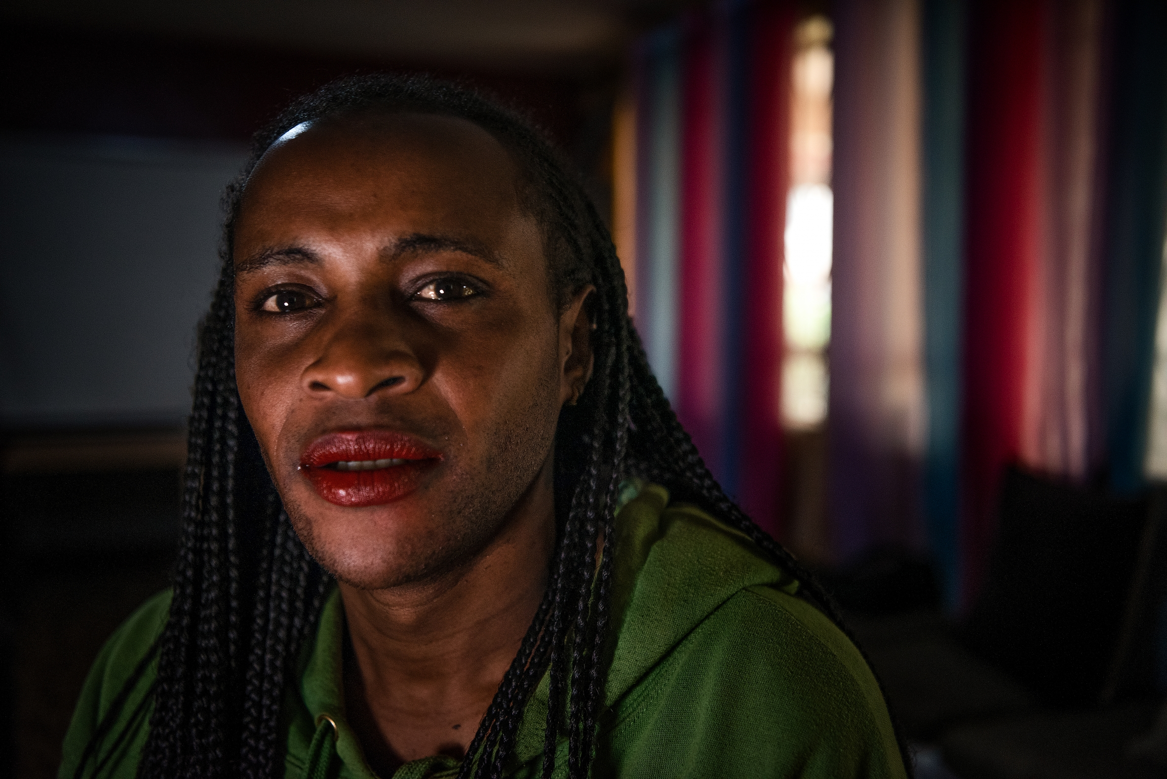 A Kenyan person with red lipstick poses for the camera