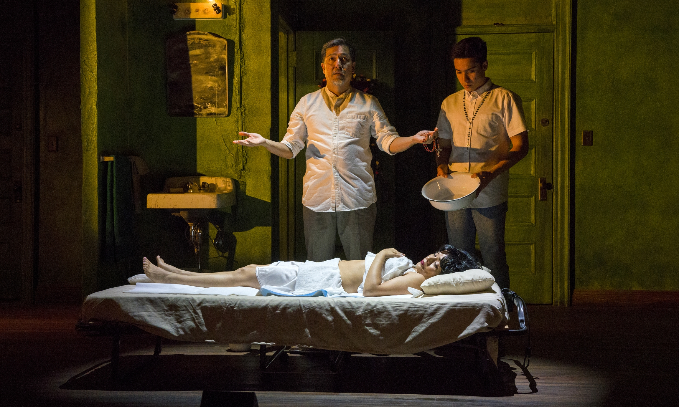 "Alan Ariano, Francisca Muñoz (on bed) and Nacho Tambunting in ""Felix Starro."""