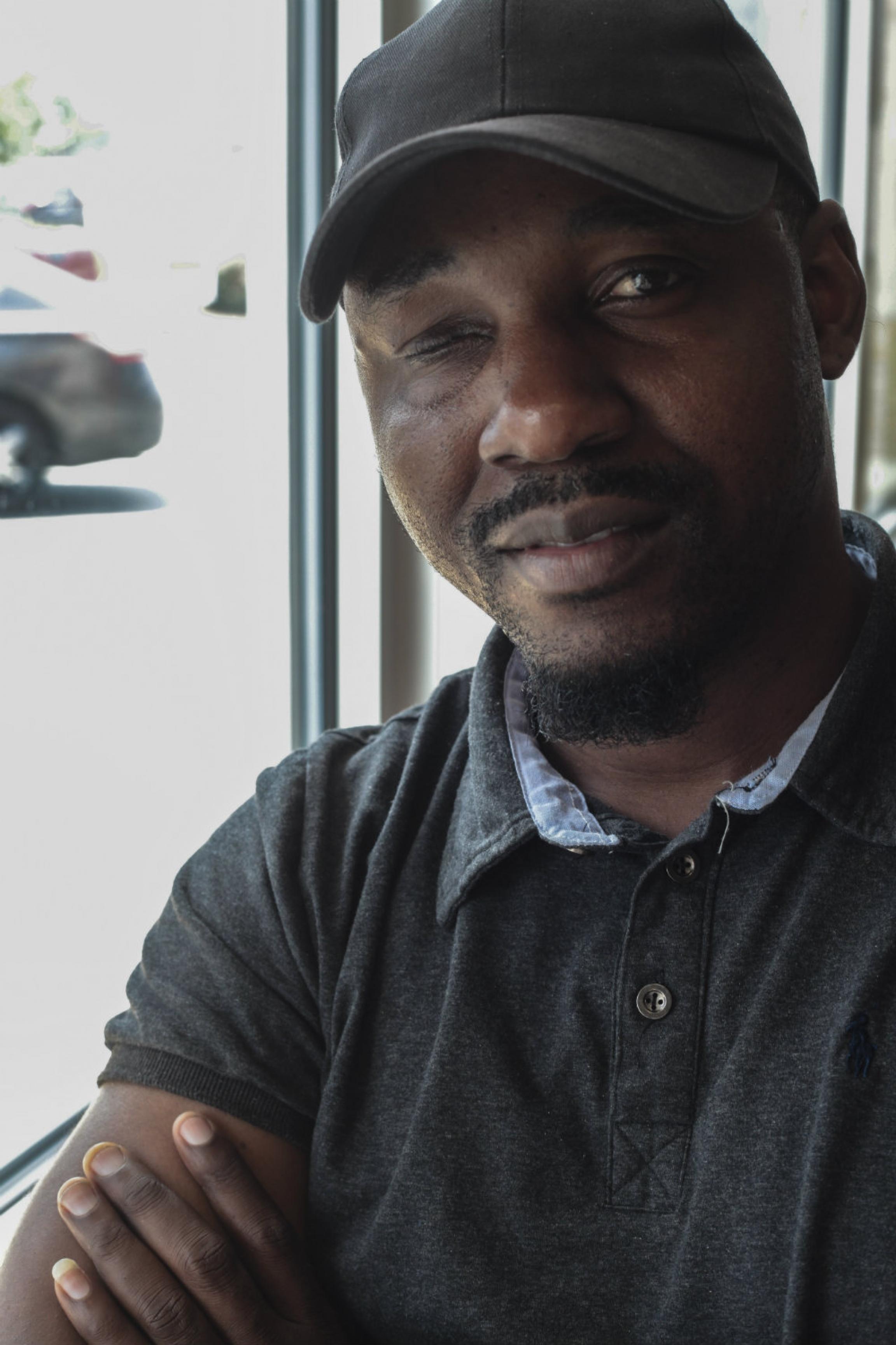 A man smiles at the camera.