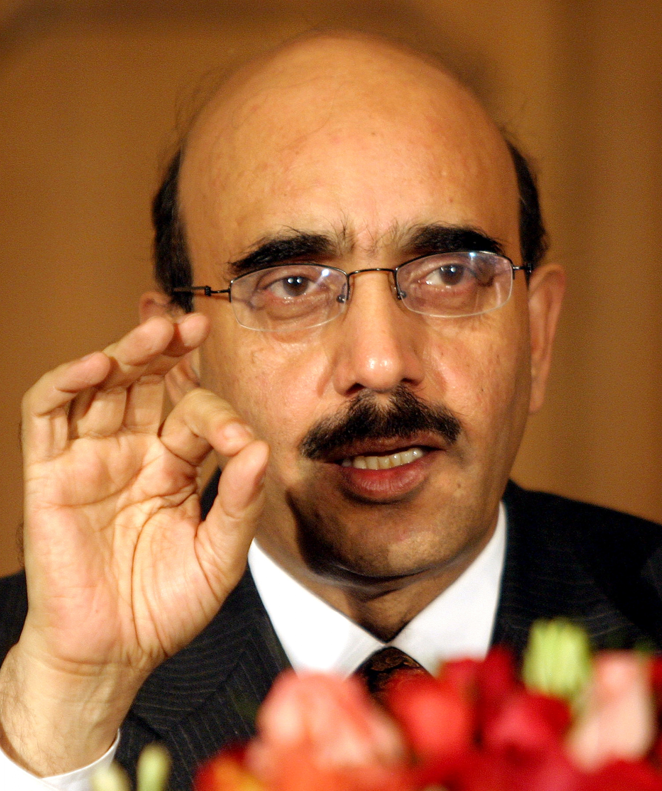 Sardar Masood Khan, president of the Pakistani side of divided Kashmir, gestures during a news conference at Pakistan's foreign ministry in Islamabad, December 23, 2004.