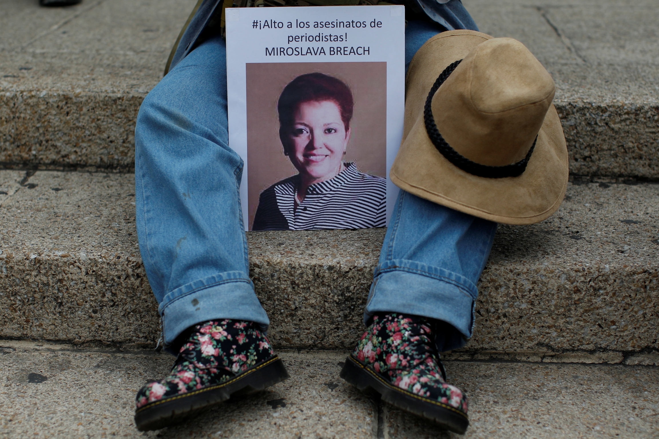 "A picture of the Mexican journalist Miroslava Breach is seen during a protest against the murder of Miroslava, in Mexico City, Mexico March 25, 2017. Picture reads ""Stop the murders of Journalists."""