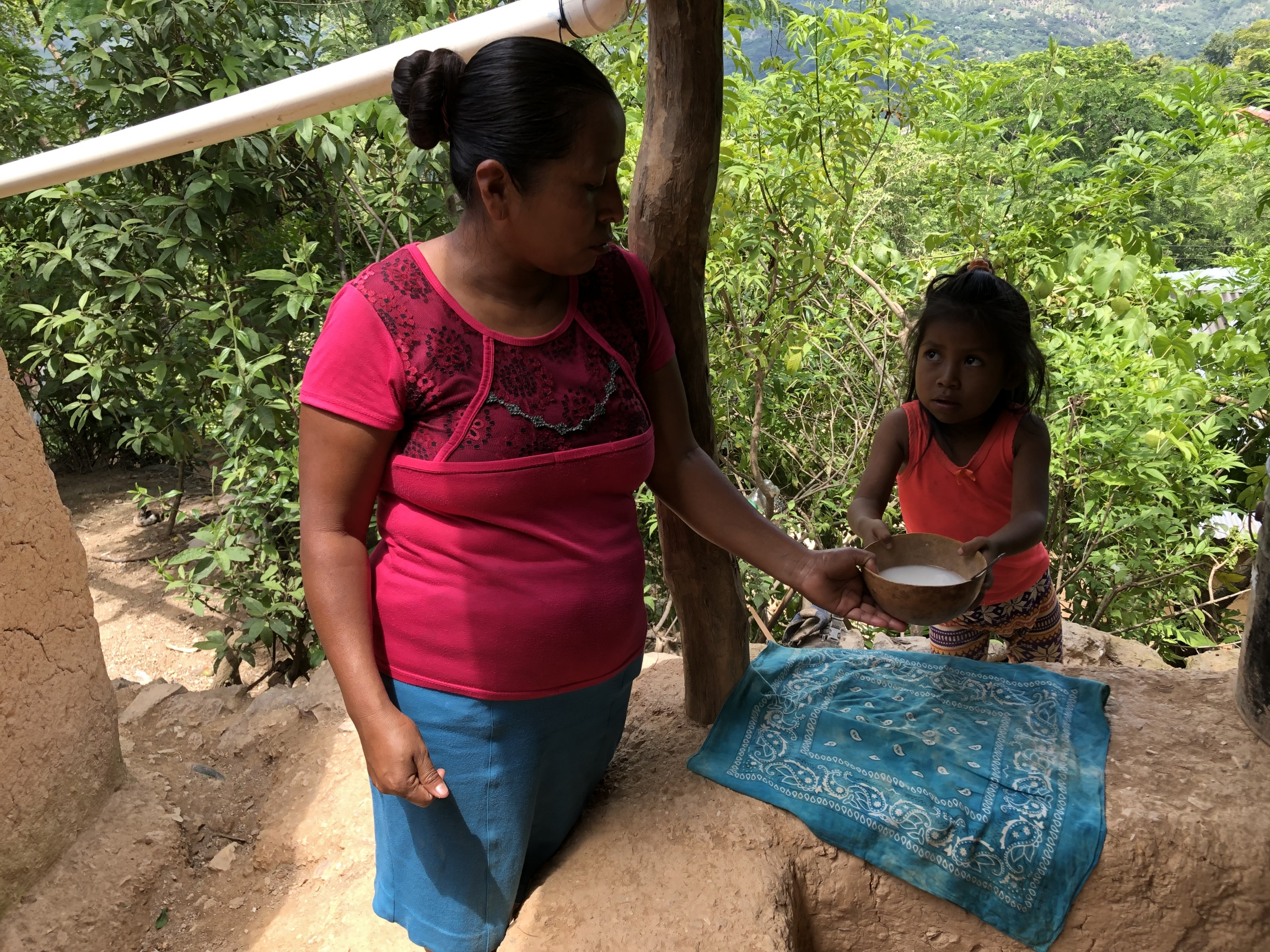 A Guatemalan mother prepares broth for her daughter, whom doctors say is malnourished.