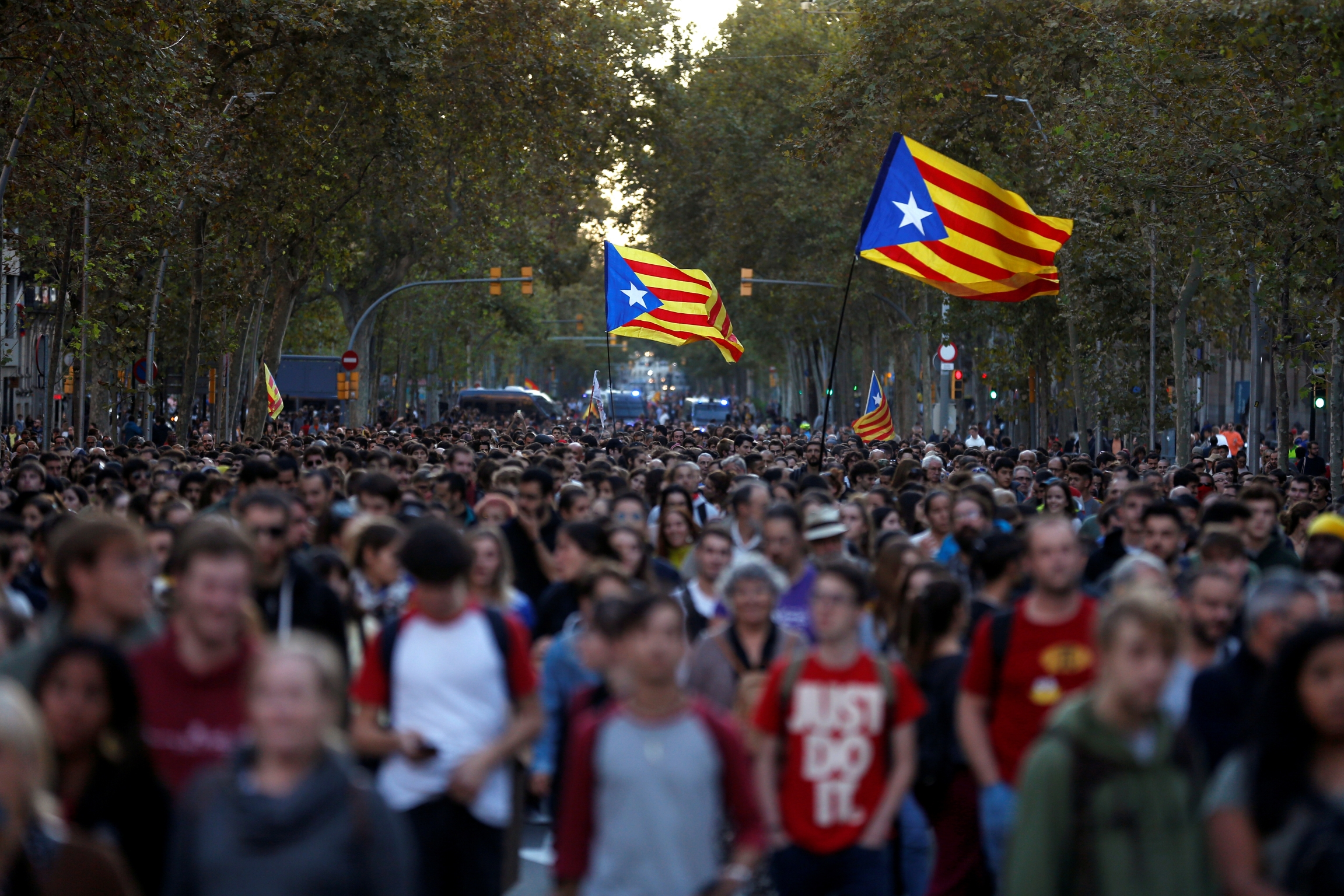Mass protests in Barcelona with protesters carrying flags