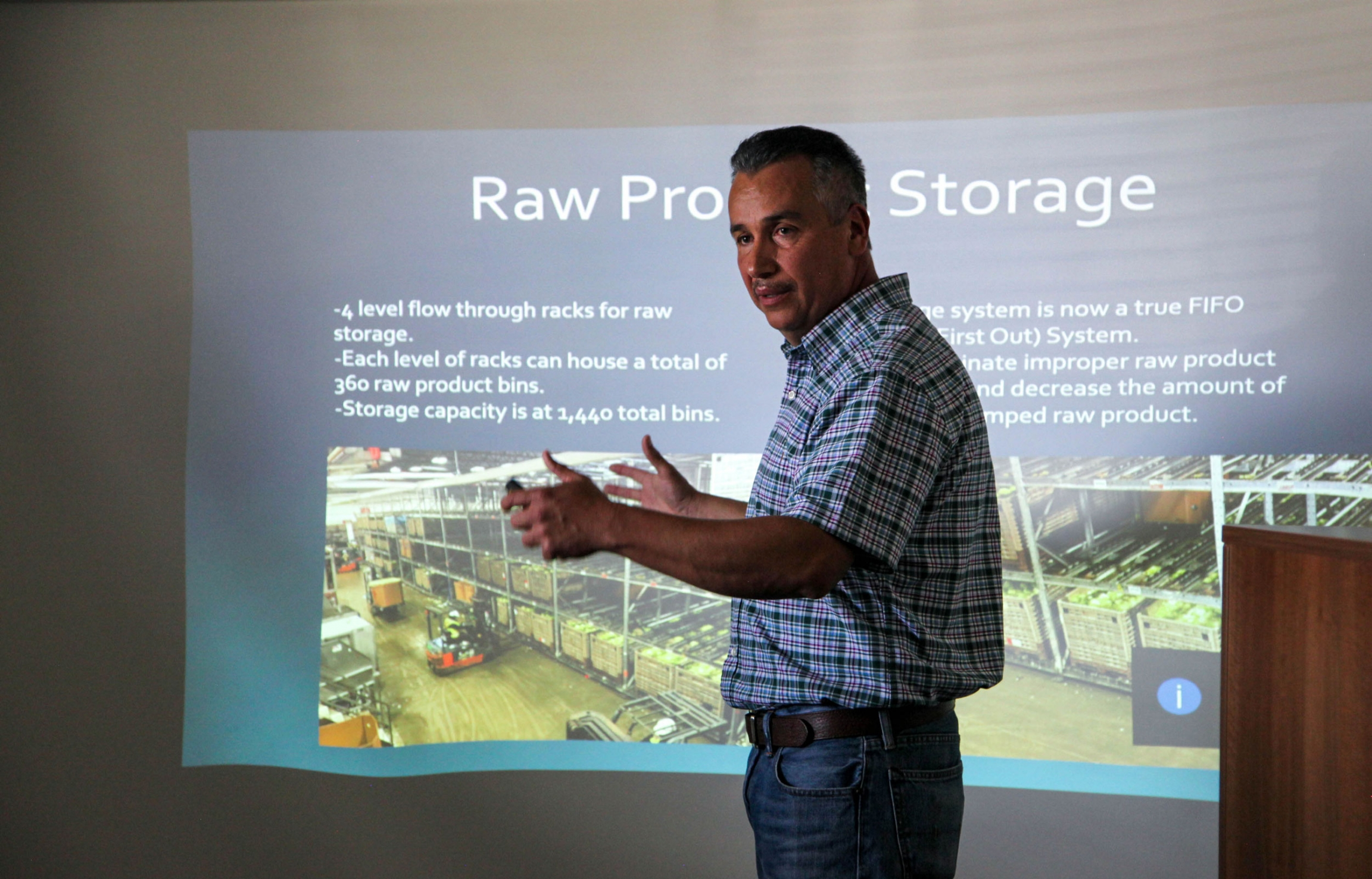 Matias Ramirez, director of facilities and automation at Taylor Farms, gives a presentation on September 10, 2019, about the new technology the company is putting in place at its processing facility.