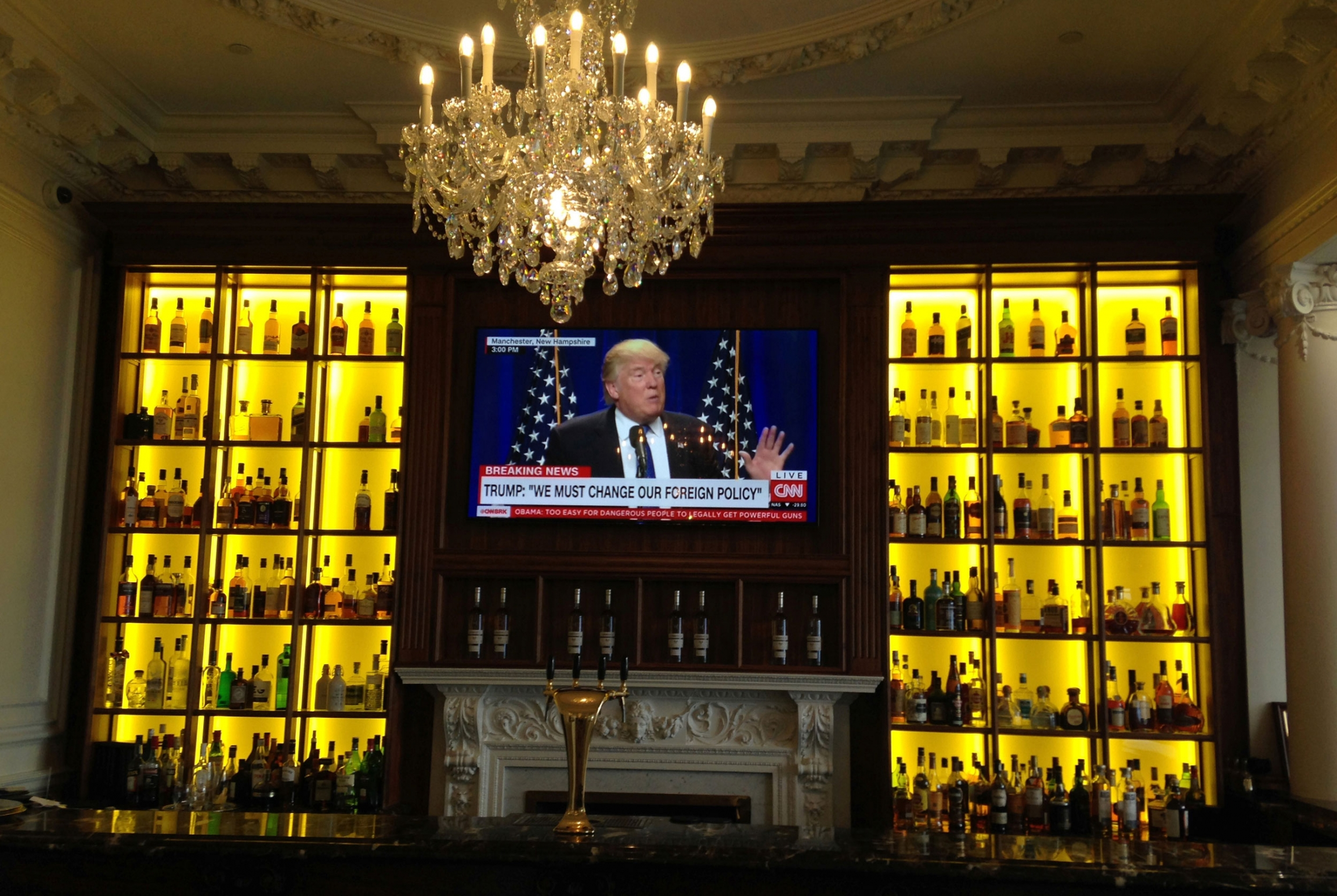 A TV screen on a bar shows US President Donald Trump