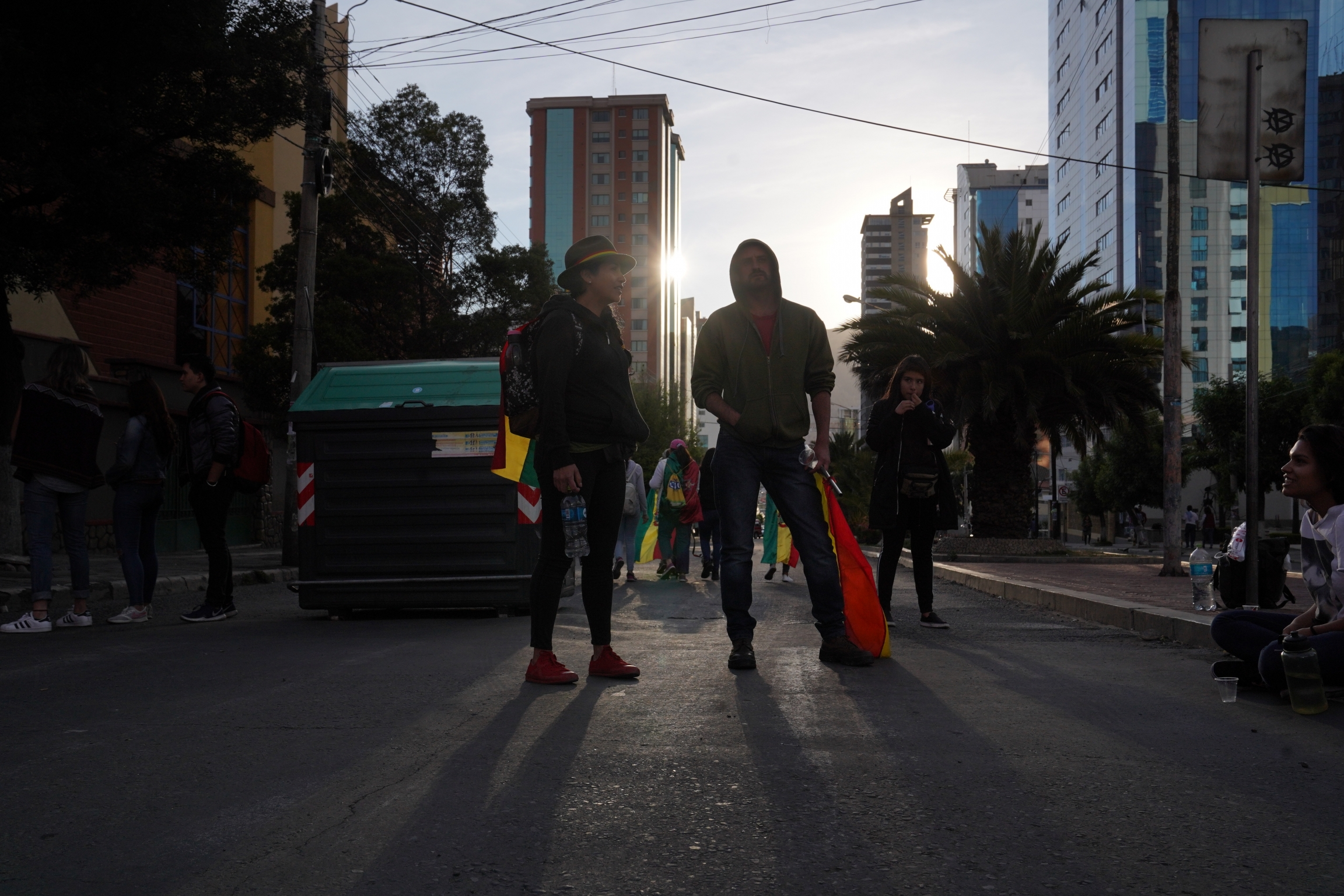 A group of young men blocks a road in Bolivia's capital city to protest the reelection of Bolivian President Evo Morales to his fourth term. Protesters claim he is leading Bolivia toward dictatorship.