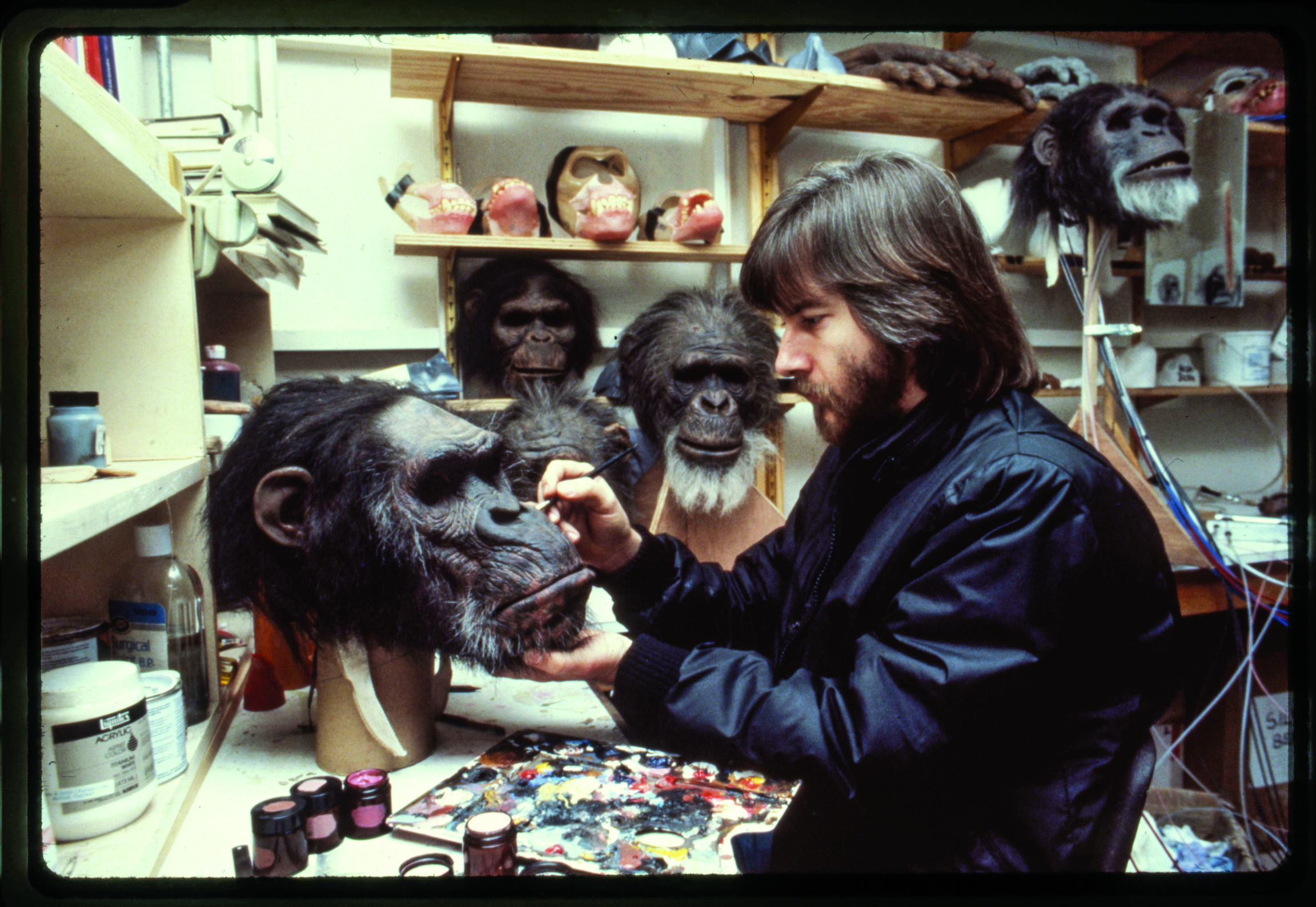 "Rick Baker in his workshop on Stage 5 at Elstree Studios, touching up the paint on White Eyes, from the movie ""Greystoke: The Legend of Tarzan, Lord of the Apes."""
