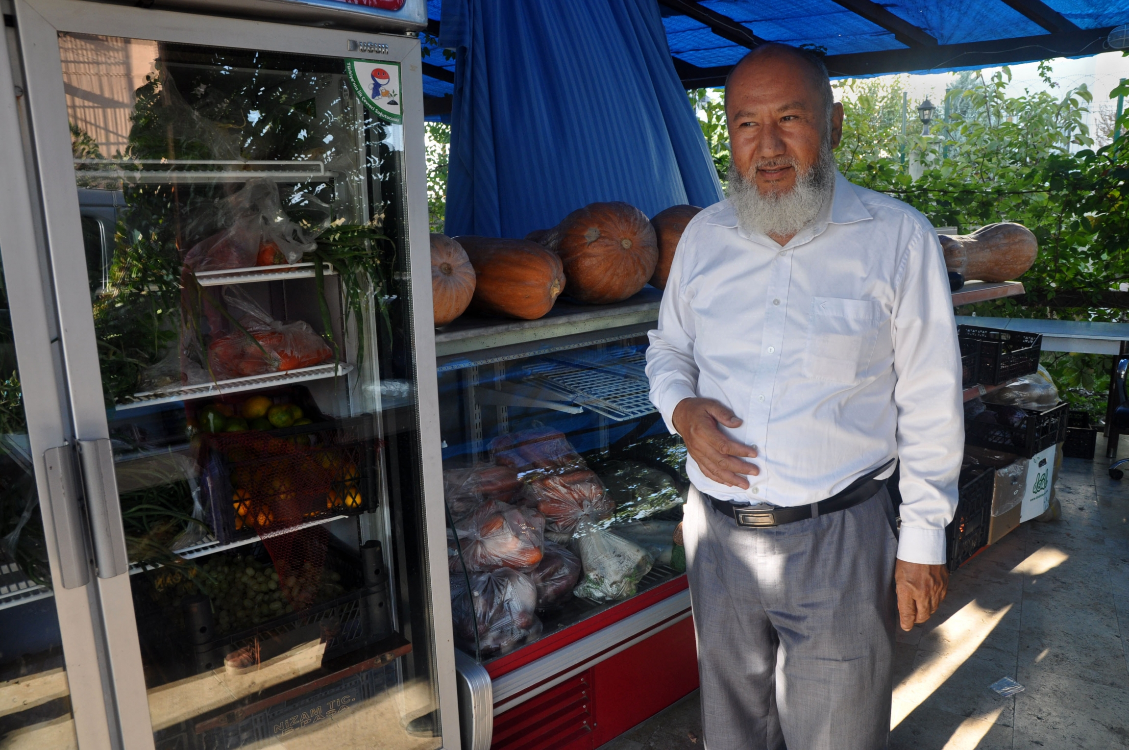 Imran Yakob is raising four of his grandchildren in Istanbul, supporting them with the proceeds of a small roadside shop.