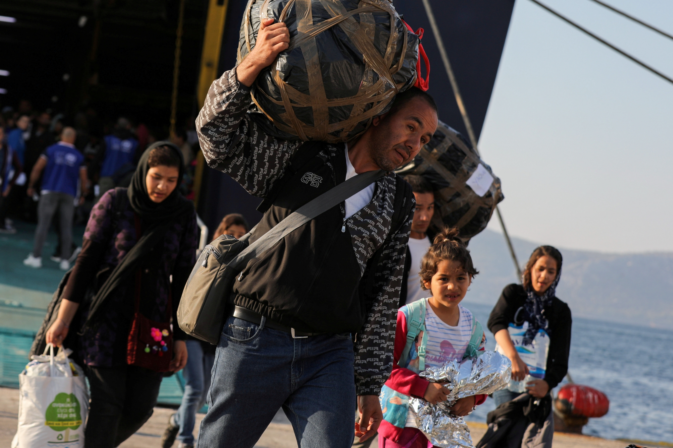 Refugeesand migrants arrive aboard the Paros Jet passenger ship at the port of Elefsina near Athens,Greece, Oct. 22, 2019.