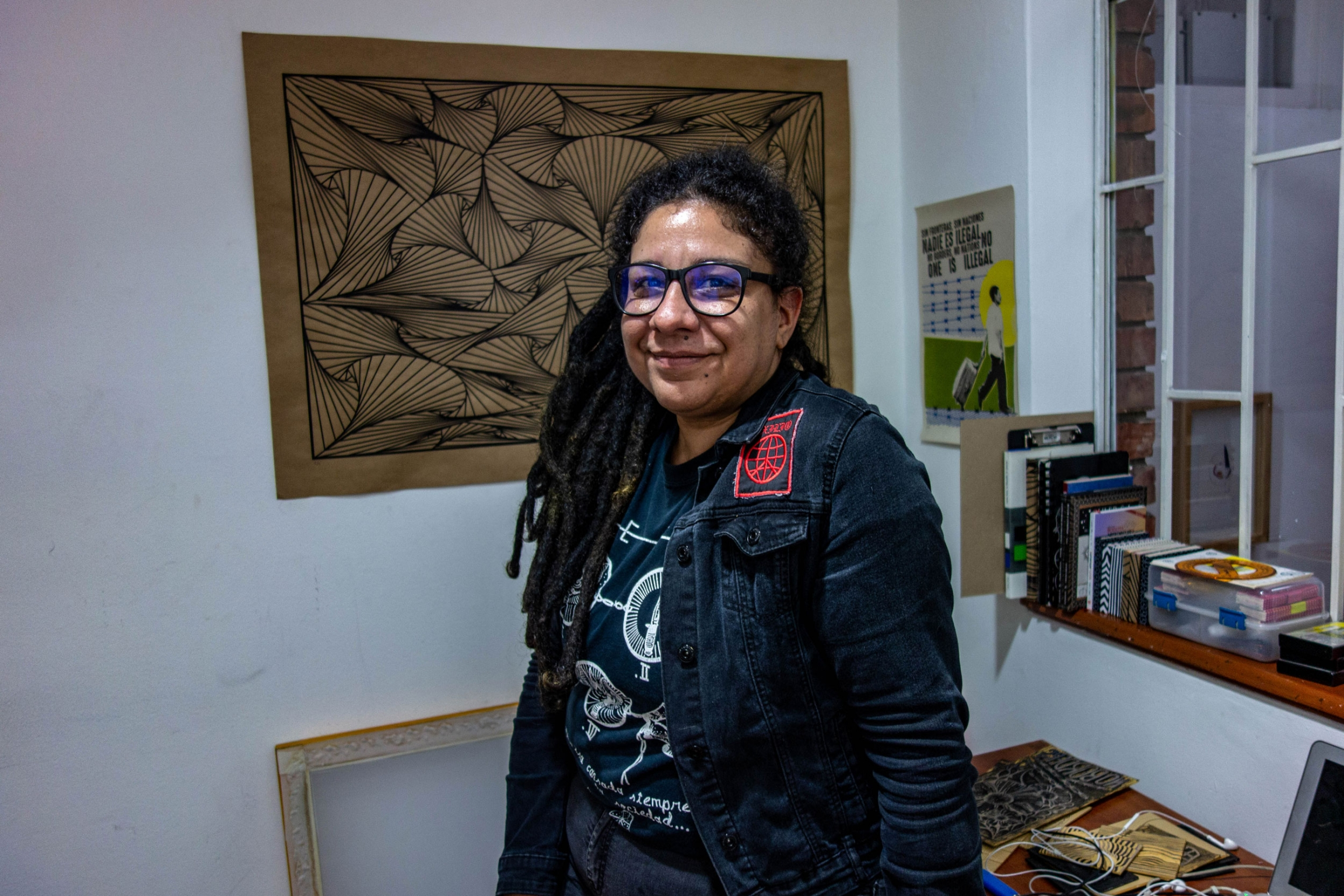 Exilio singer Susana González is shown wearing dread locks and glasses.