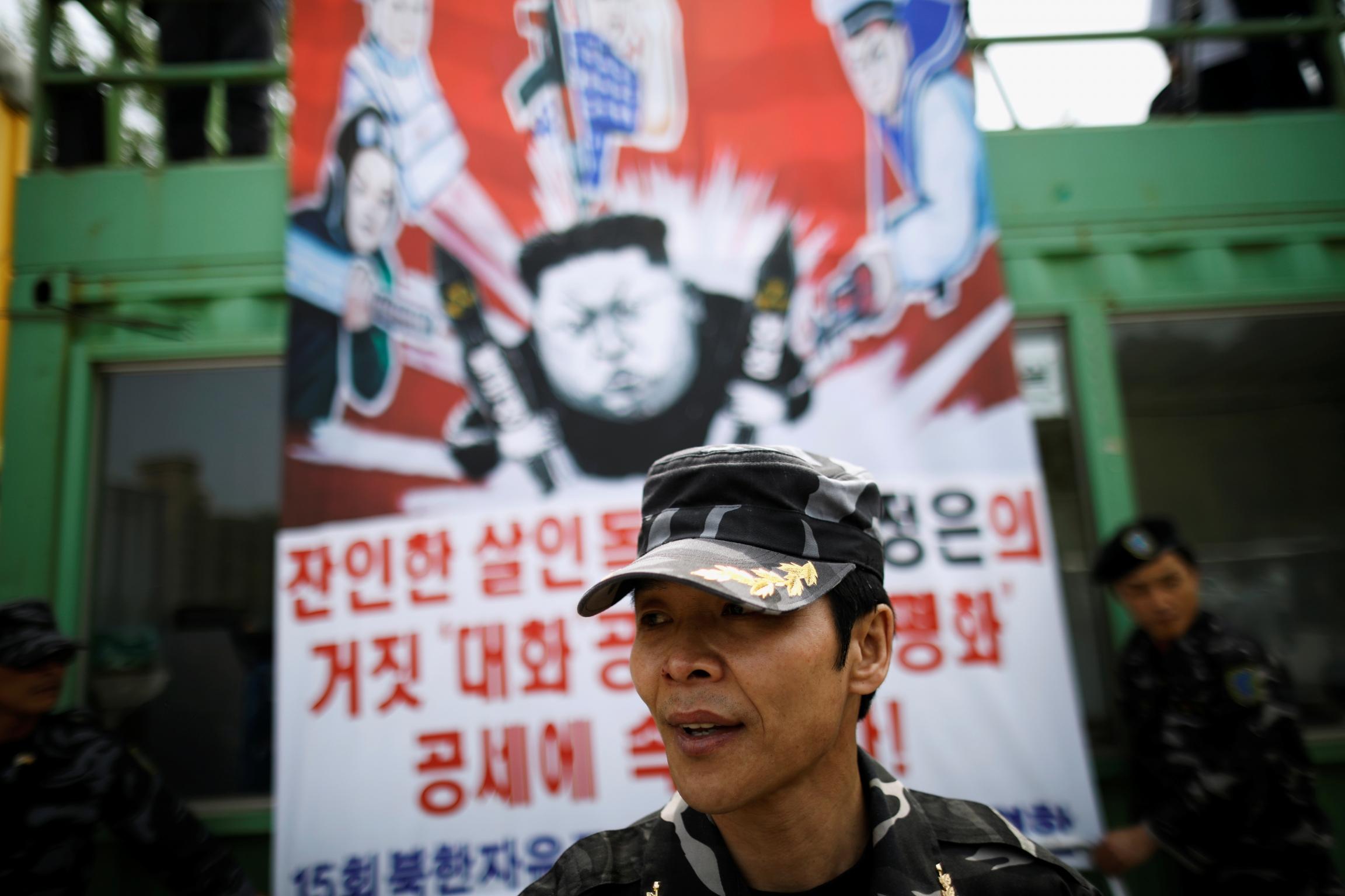 ANorthKorean defector, a member of an anti-NorthKoreacivic group, prepares to release balloons containing leaflets denouncingNorthKorean leader Kim Jong-un