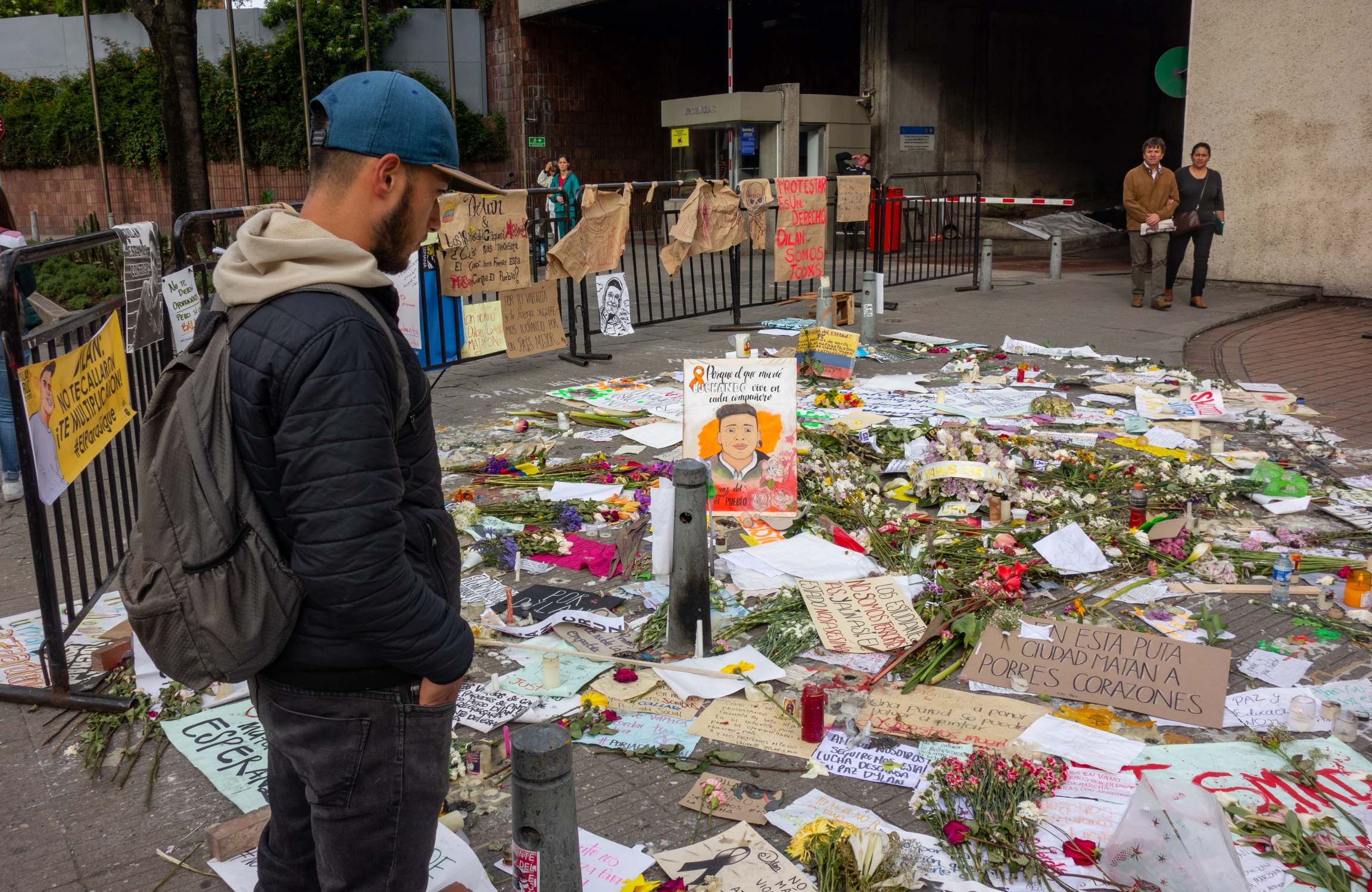 A young man pays tribute to a memorial for slain protester