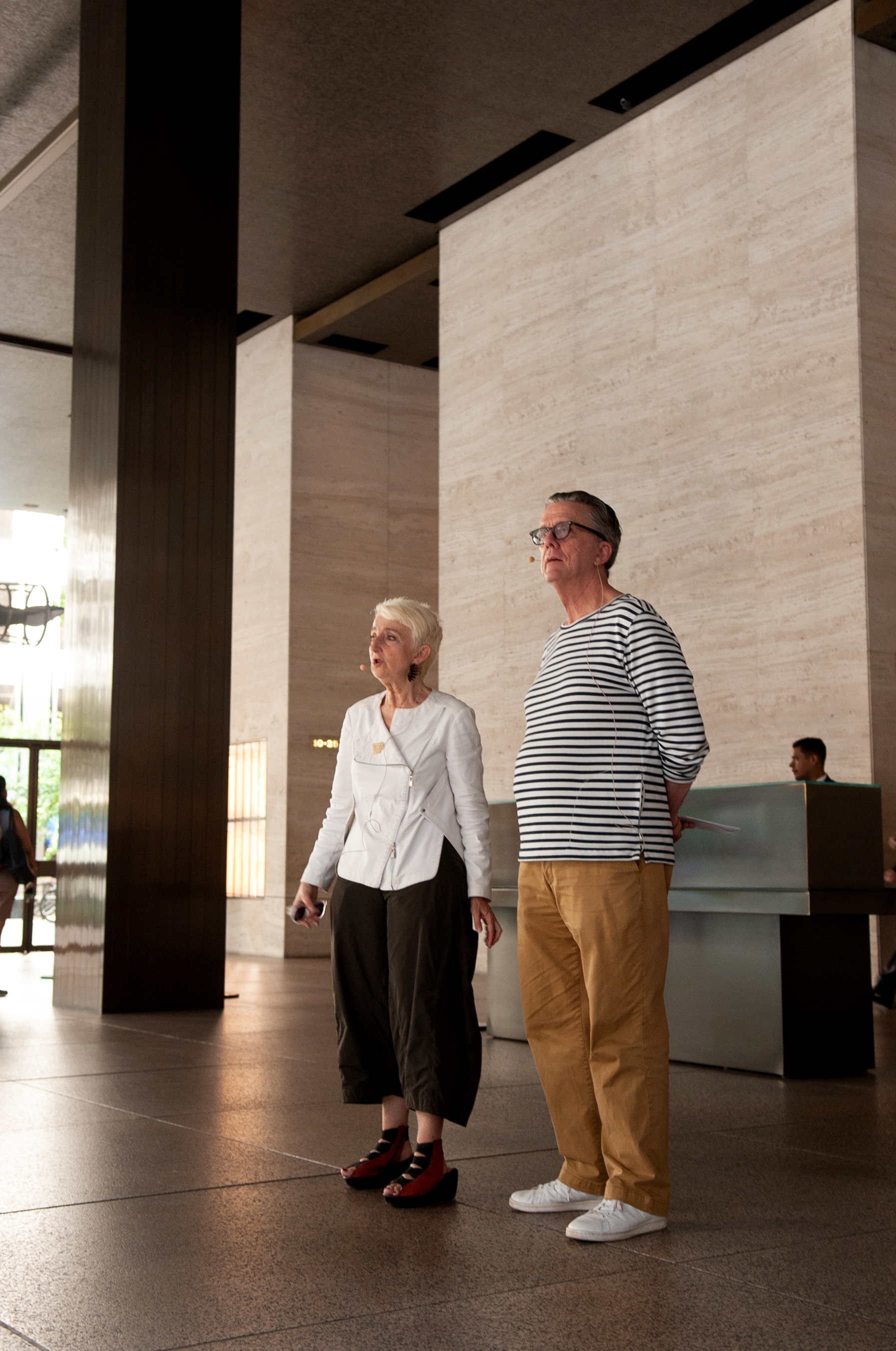 Frances Bronet and Kurt Andersen stand in the Seagrams lobby.