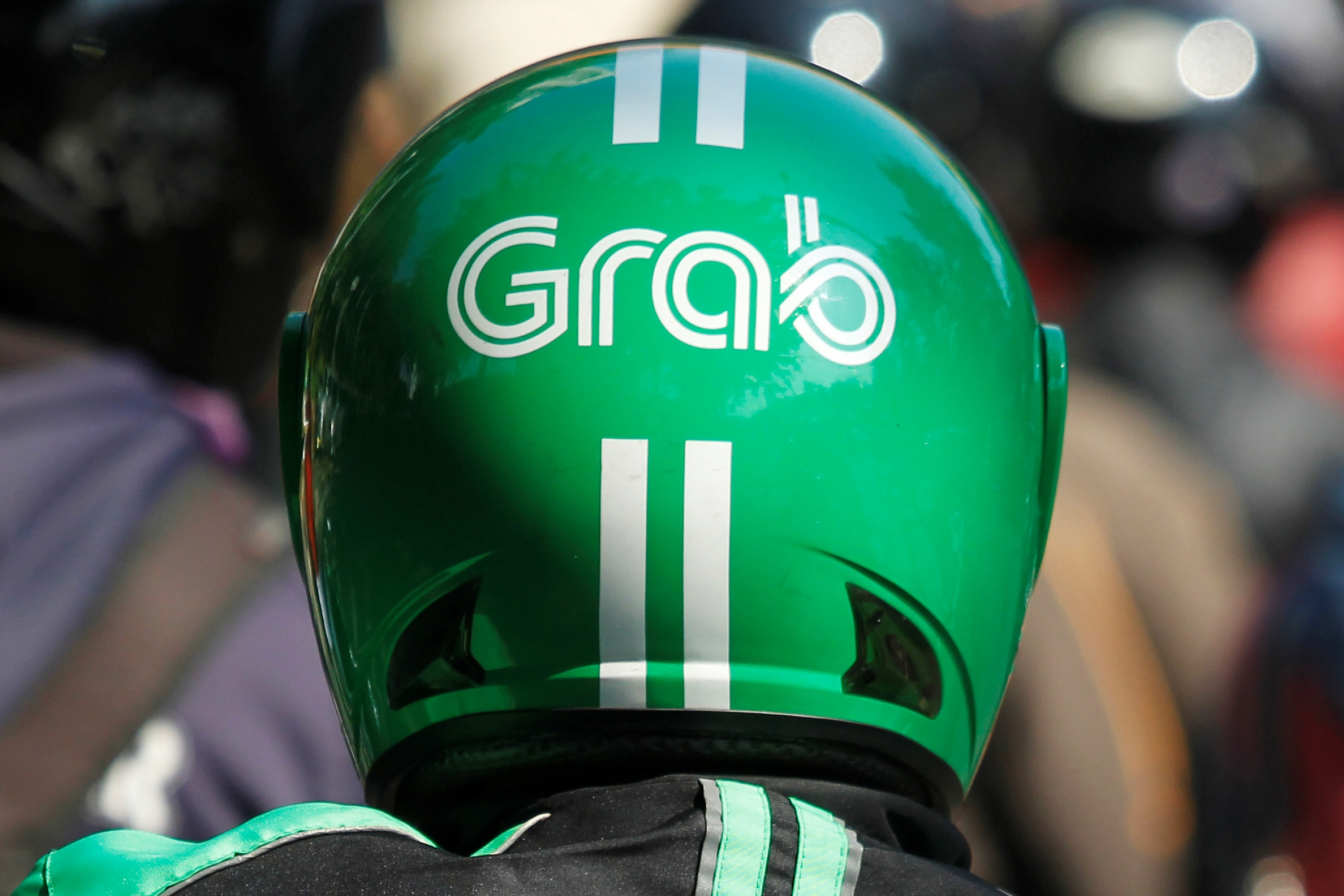 A Grab green helmet up close