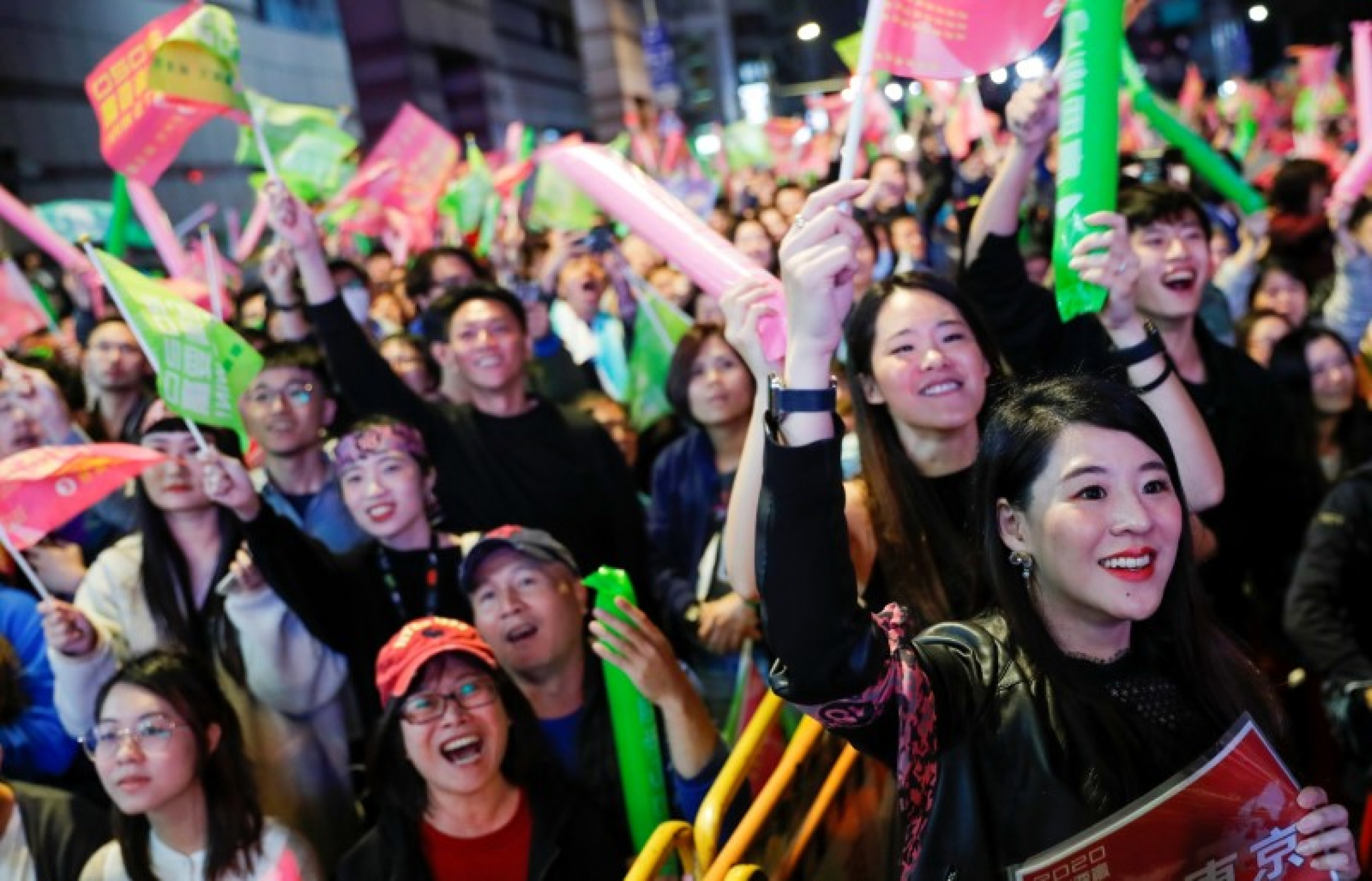 Supporters of Taiwan President Tsai Ing-wen react during a rally outside the Democratic Progressive Party (DPP) headquarters in Taipei, Taiwan, on January 11, 2020.