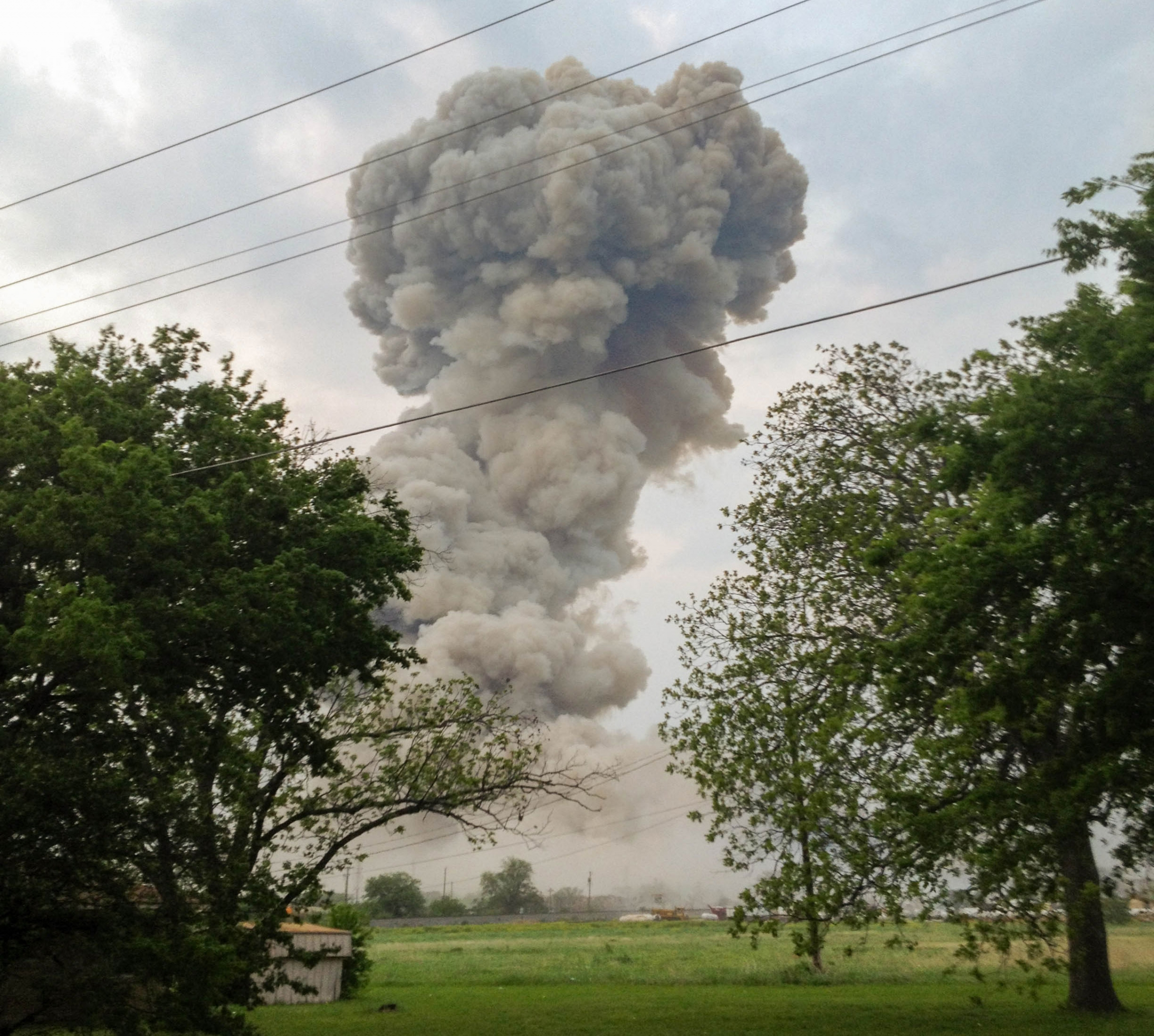 A plume of smoke is seen in the distance following an explosion.