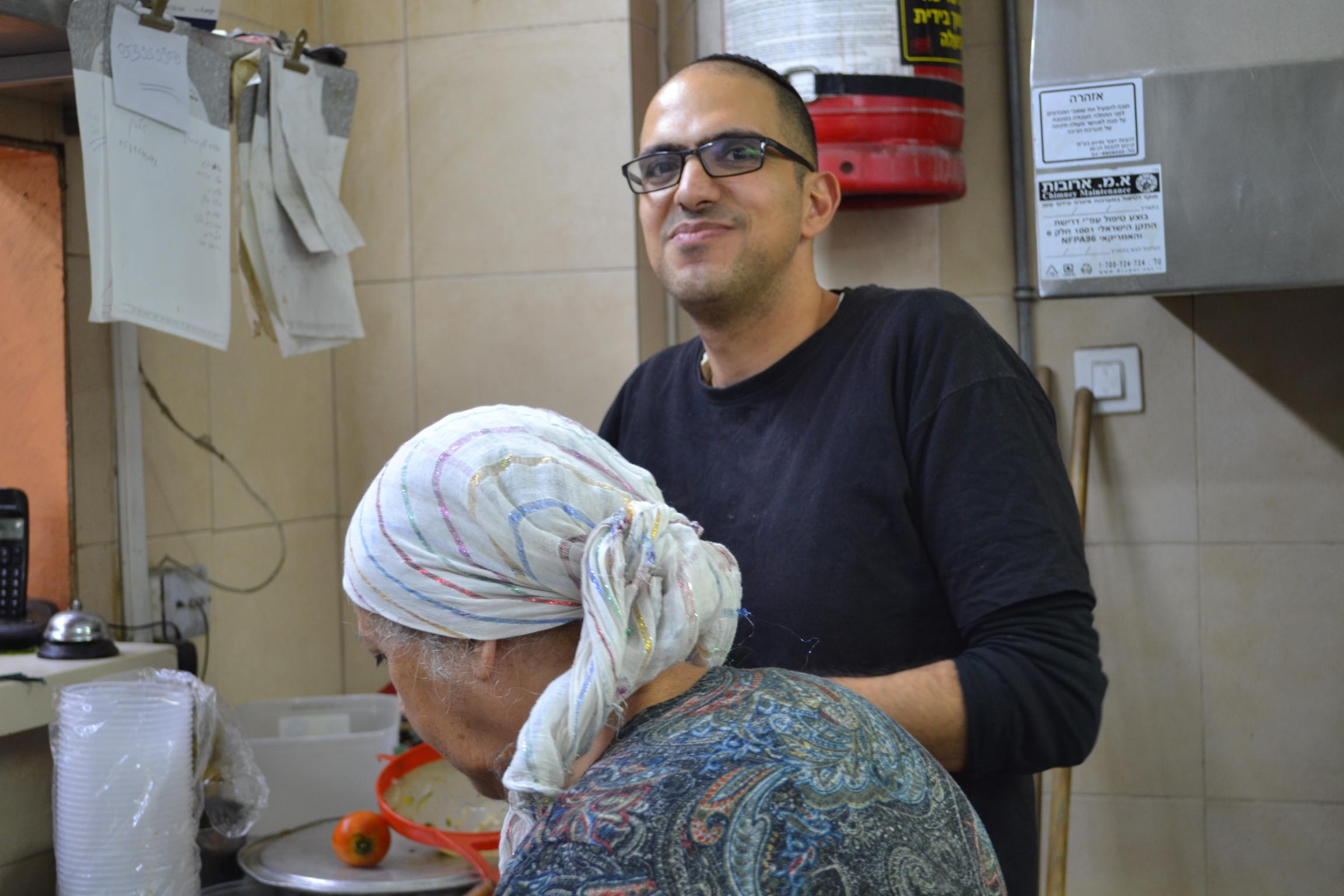 Avi Hanasav with his mother Moluk Hanasav at Shamshiri, the Persian restaurant they own together in Tel Aviv, Israel.