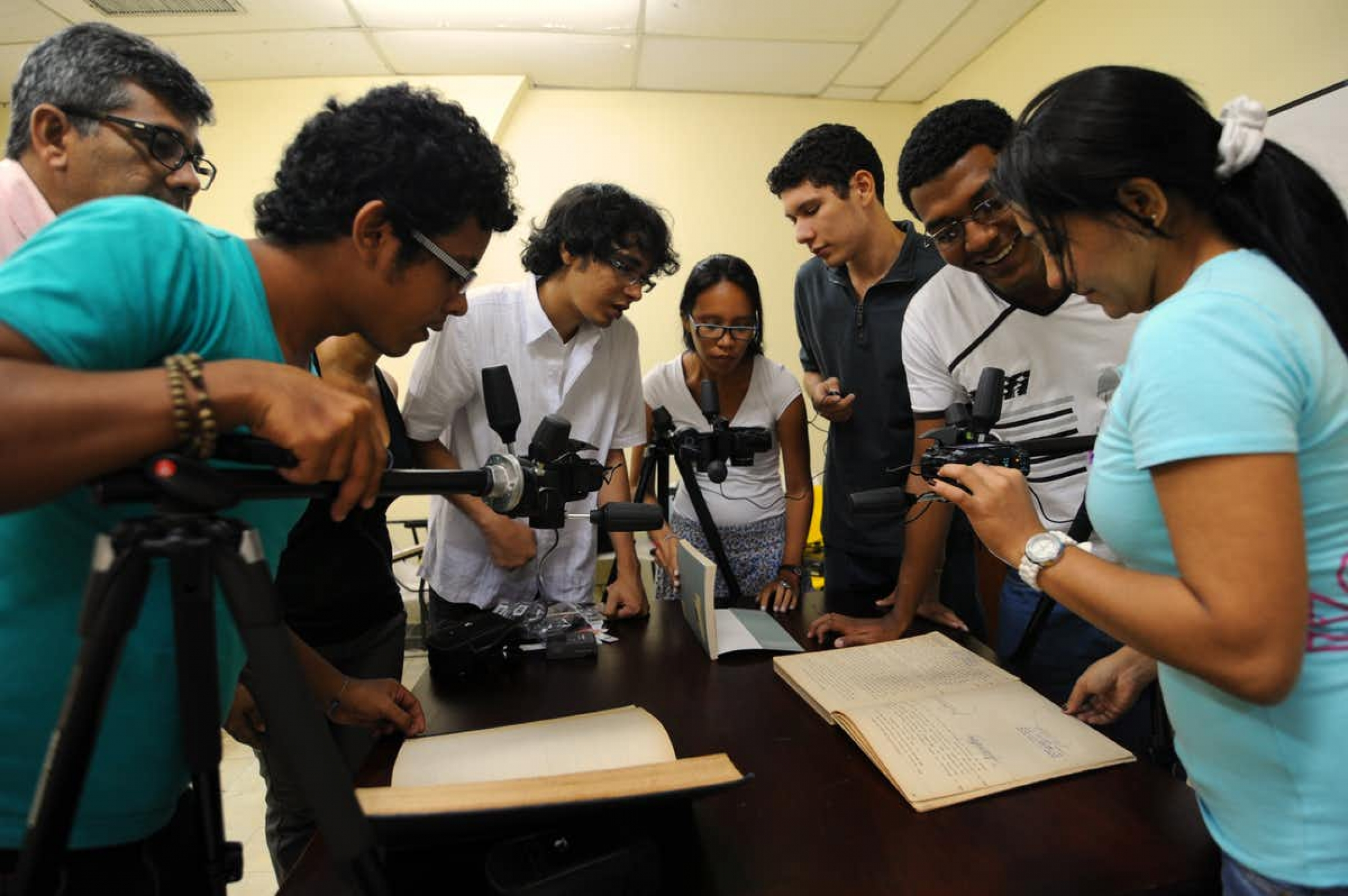 A lot of people get involved, both teaching and learning how to properly photograph documents.