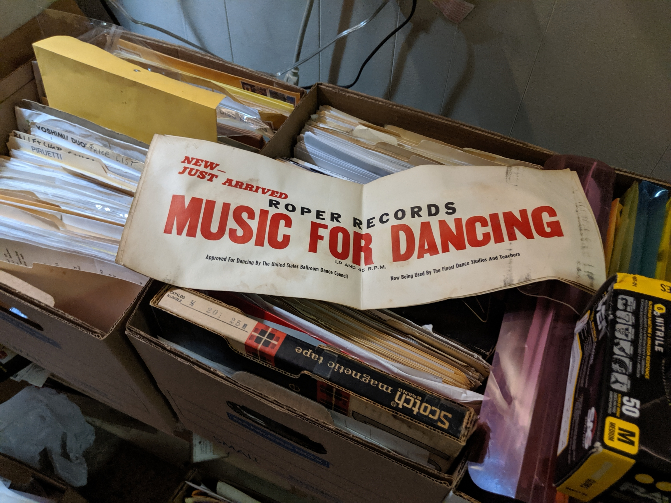 """A Roper Records banner over filing boxes. The banner reads """"music for dancing."""""""