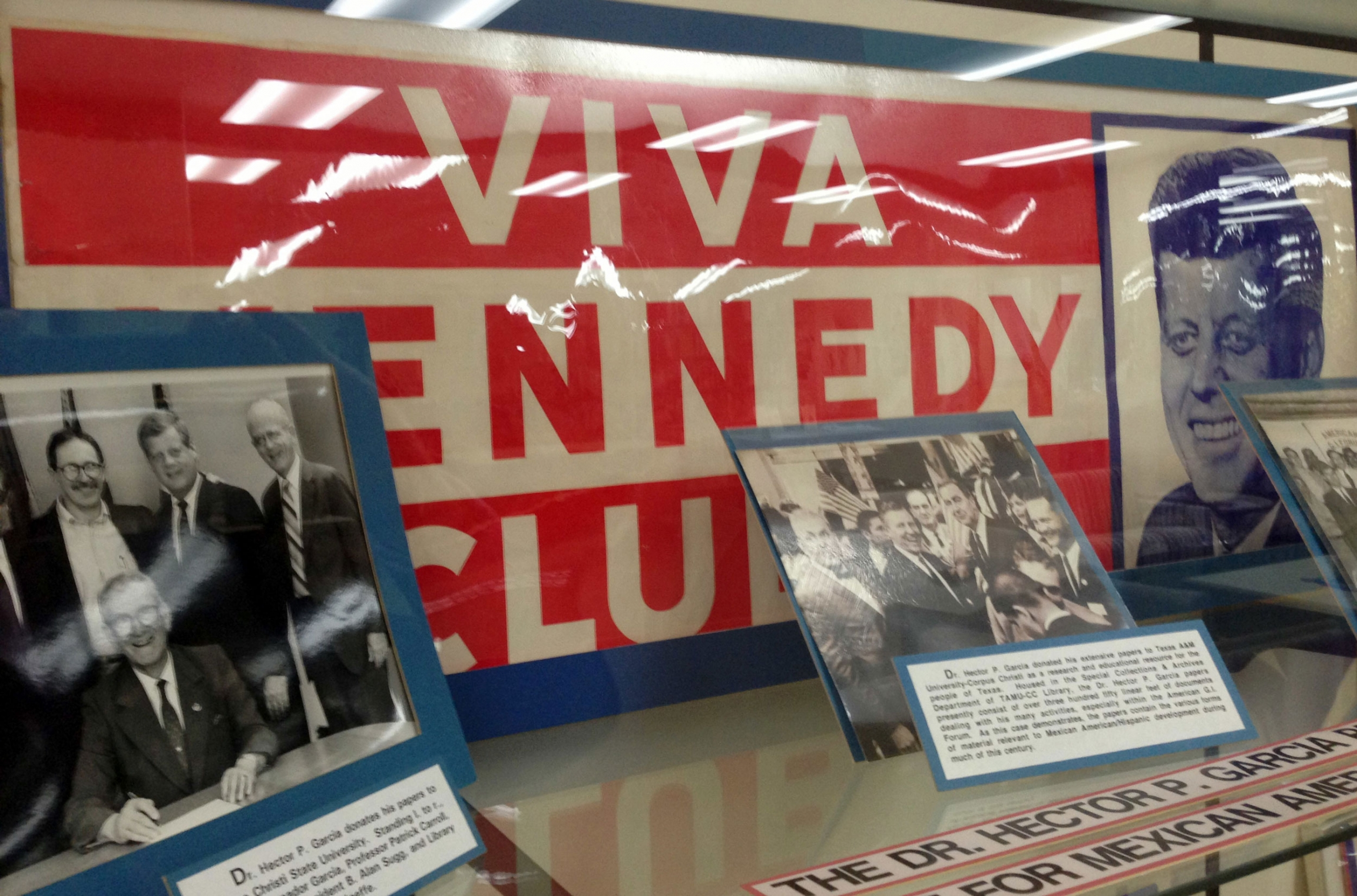 Old Viva Kennedy! campaign buttons of civil rights leader and G.I. Forum founder Dr. Hector P. Garcia, lower left, are shown at the Garcia exhibit at Texas A&M-Corpus Christi, Texas.