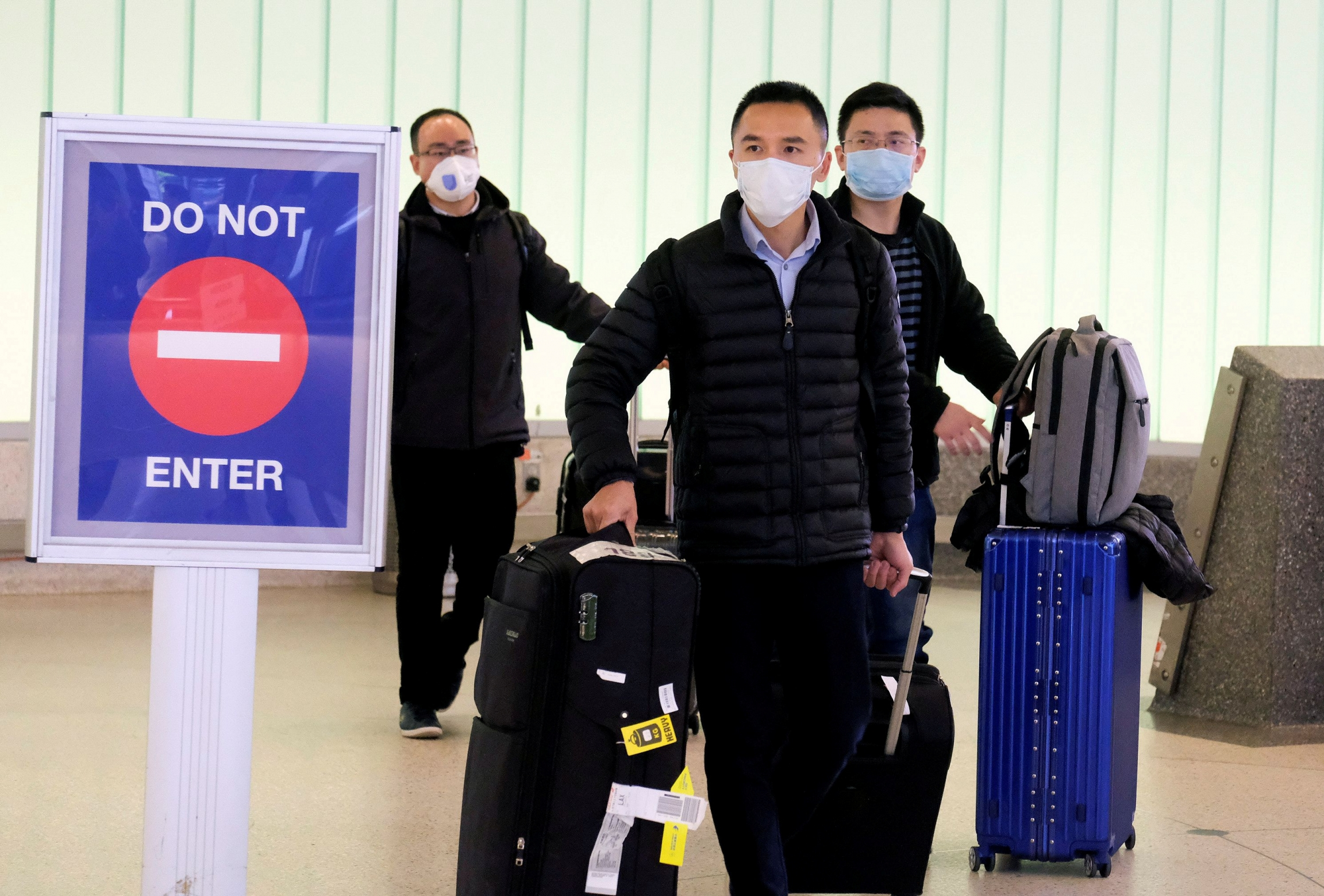 Passengers arrive at LAX from Shanghai, China, after a positive case of the coronavirus was announced in the Orange County suburb of Los Angeles, Jan. 26, 2020.