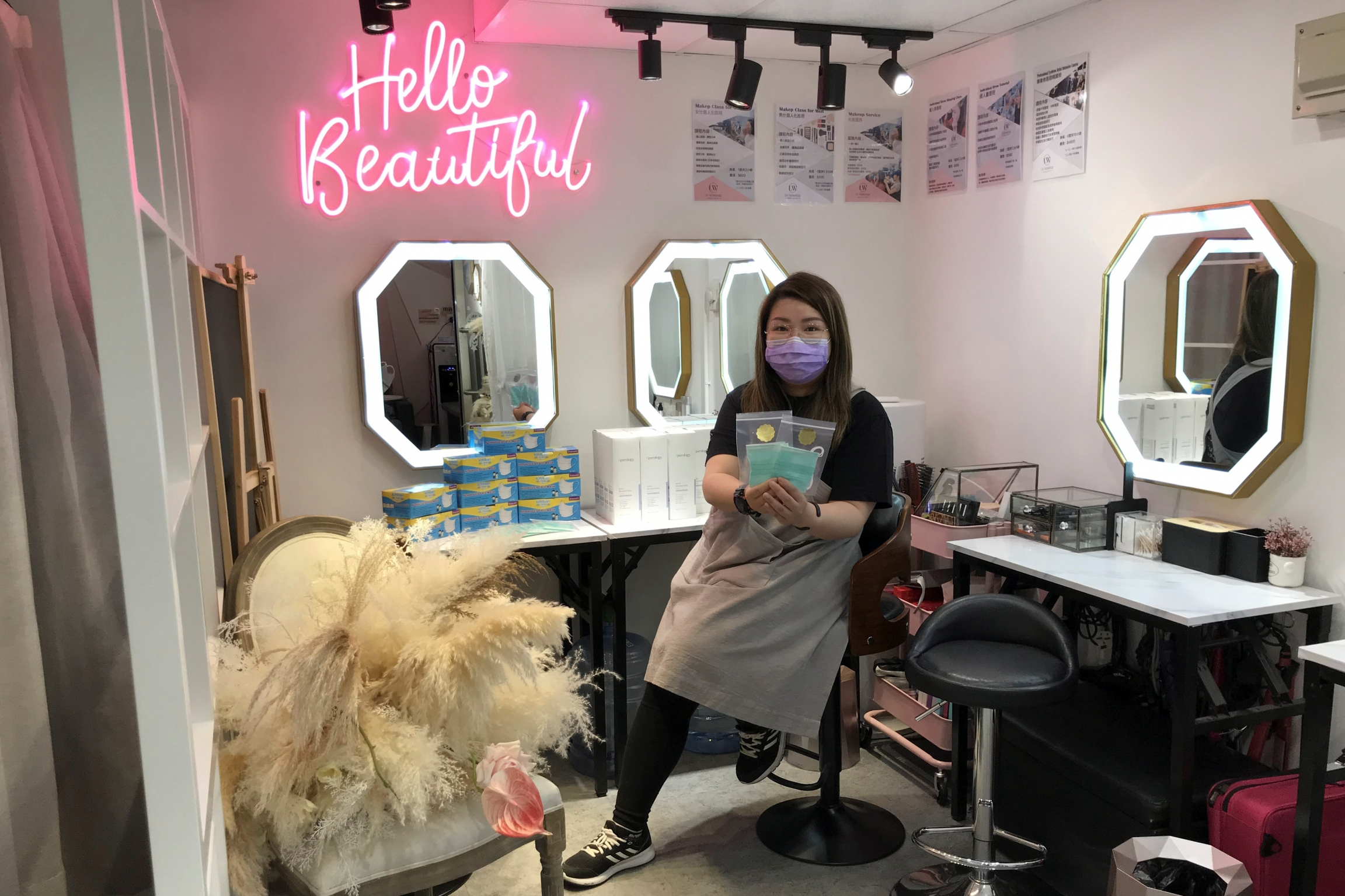 A woman sits in a beauty salon