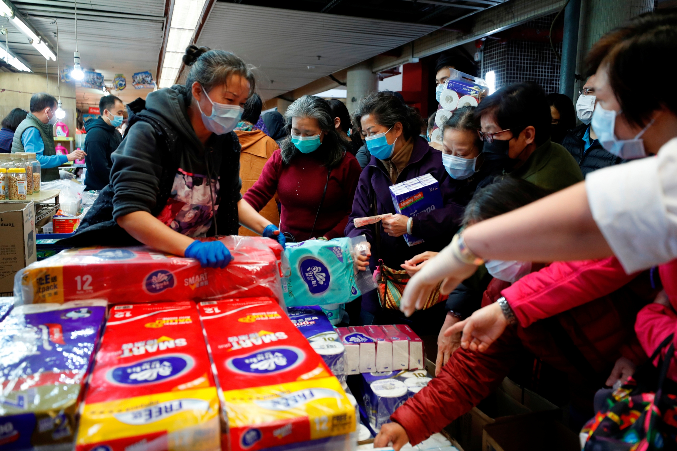 Customers pick paper products at a market, following the outbreak of COVID-19, in Hong Kong, China Feb. 11, 2020.